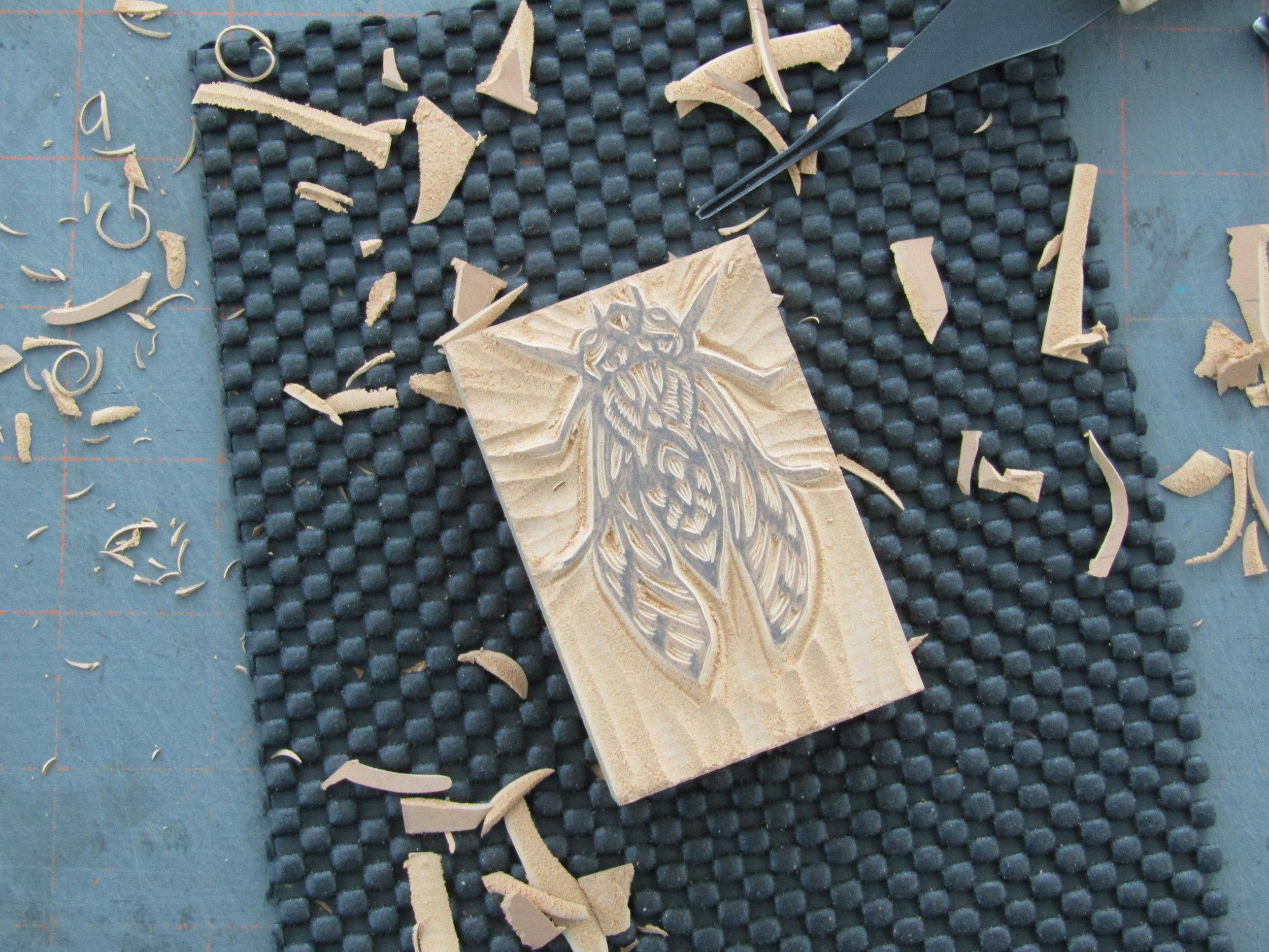 Carving the cicada.