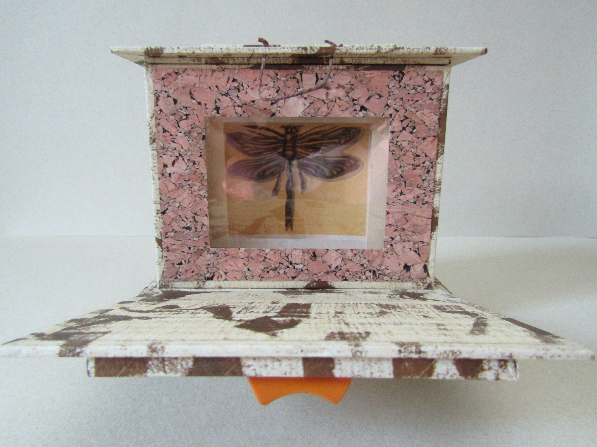 Dragonfly reliquary with the door opened.