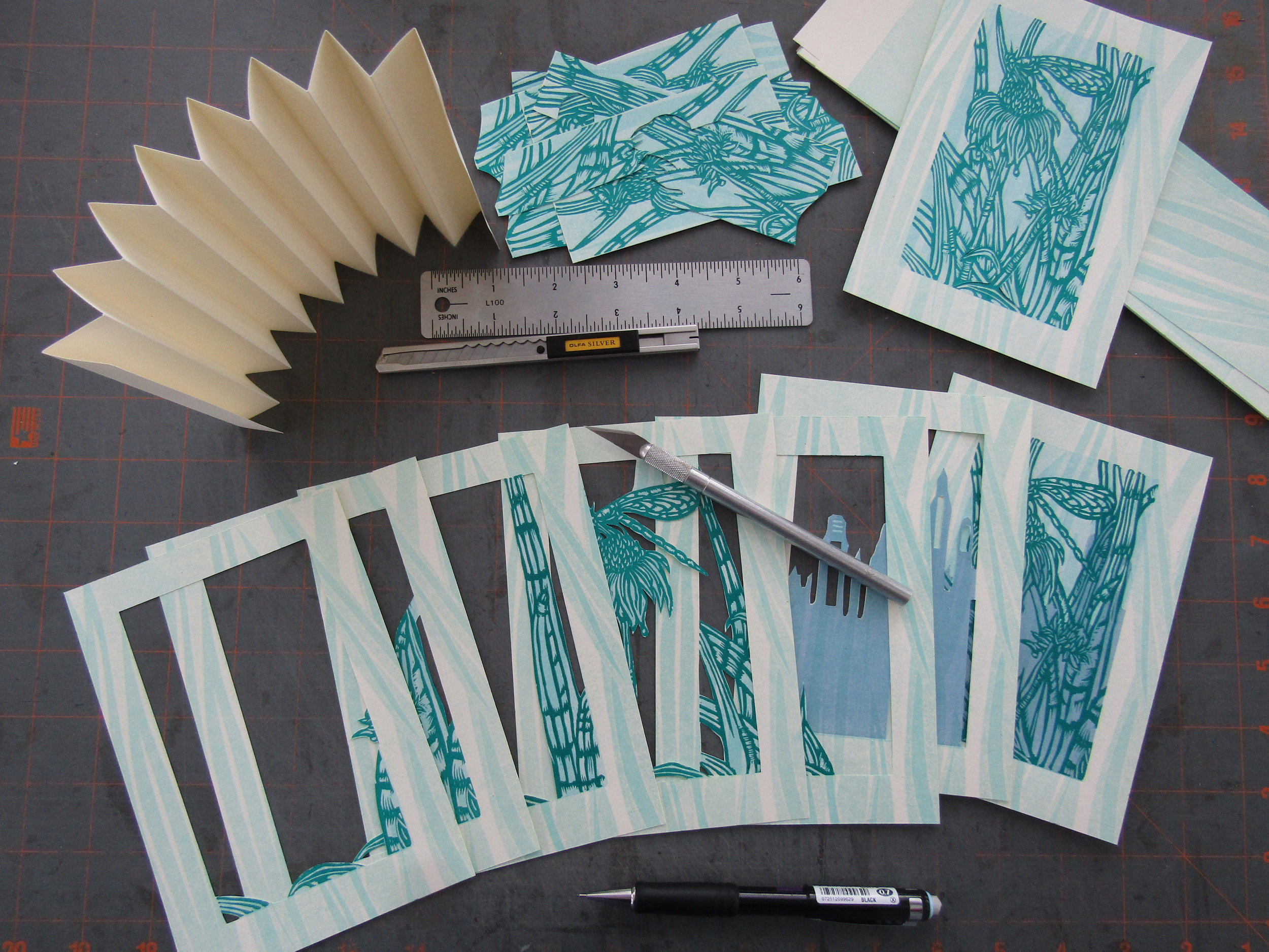 Once I had the blocks printed; I began constructing the book. It is always exciting to cut and layer the pages for a tunnel book!