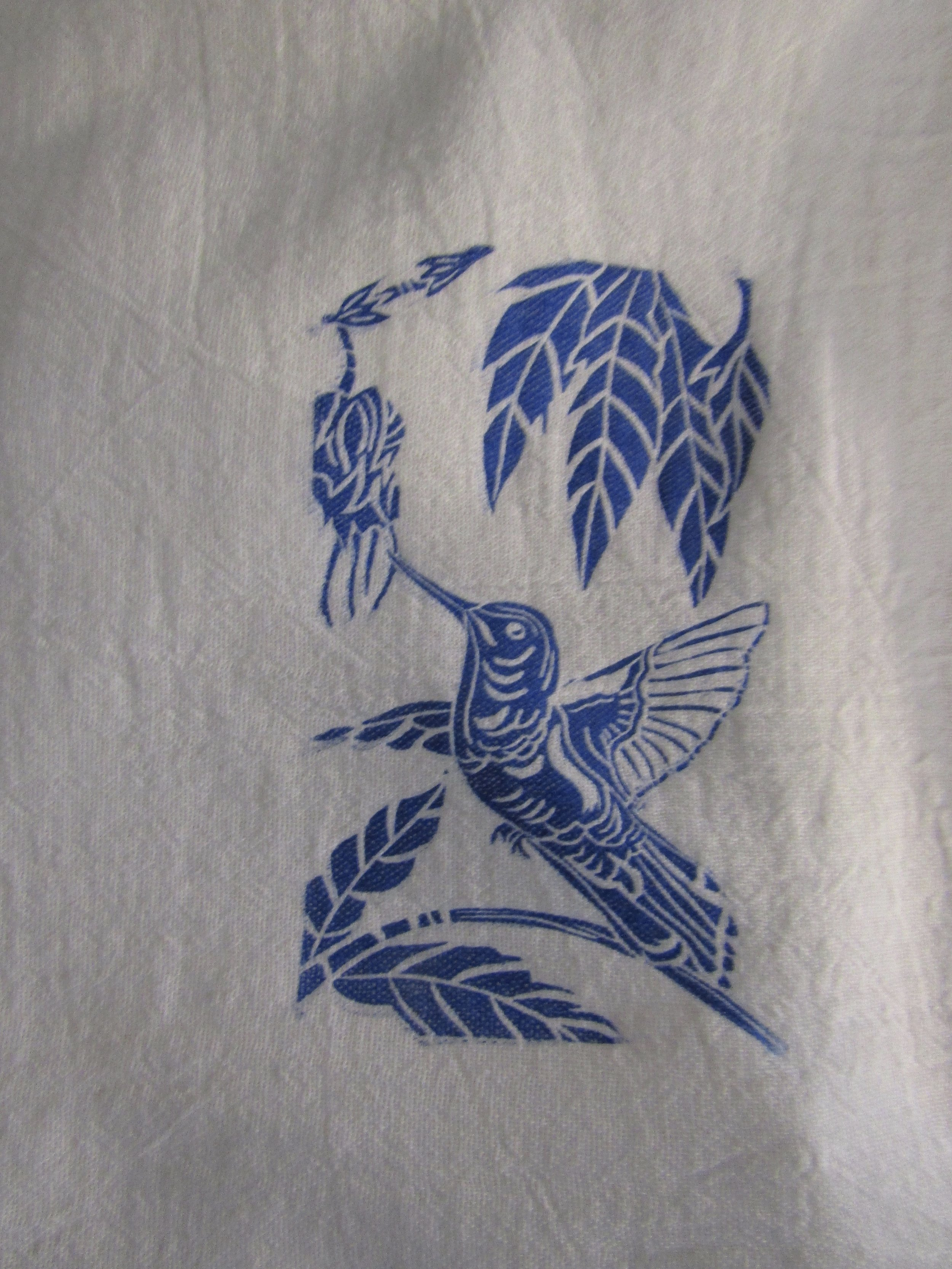 A little hummingbird adorns this towel.
