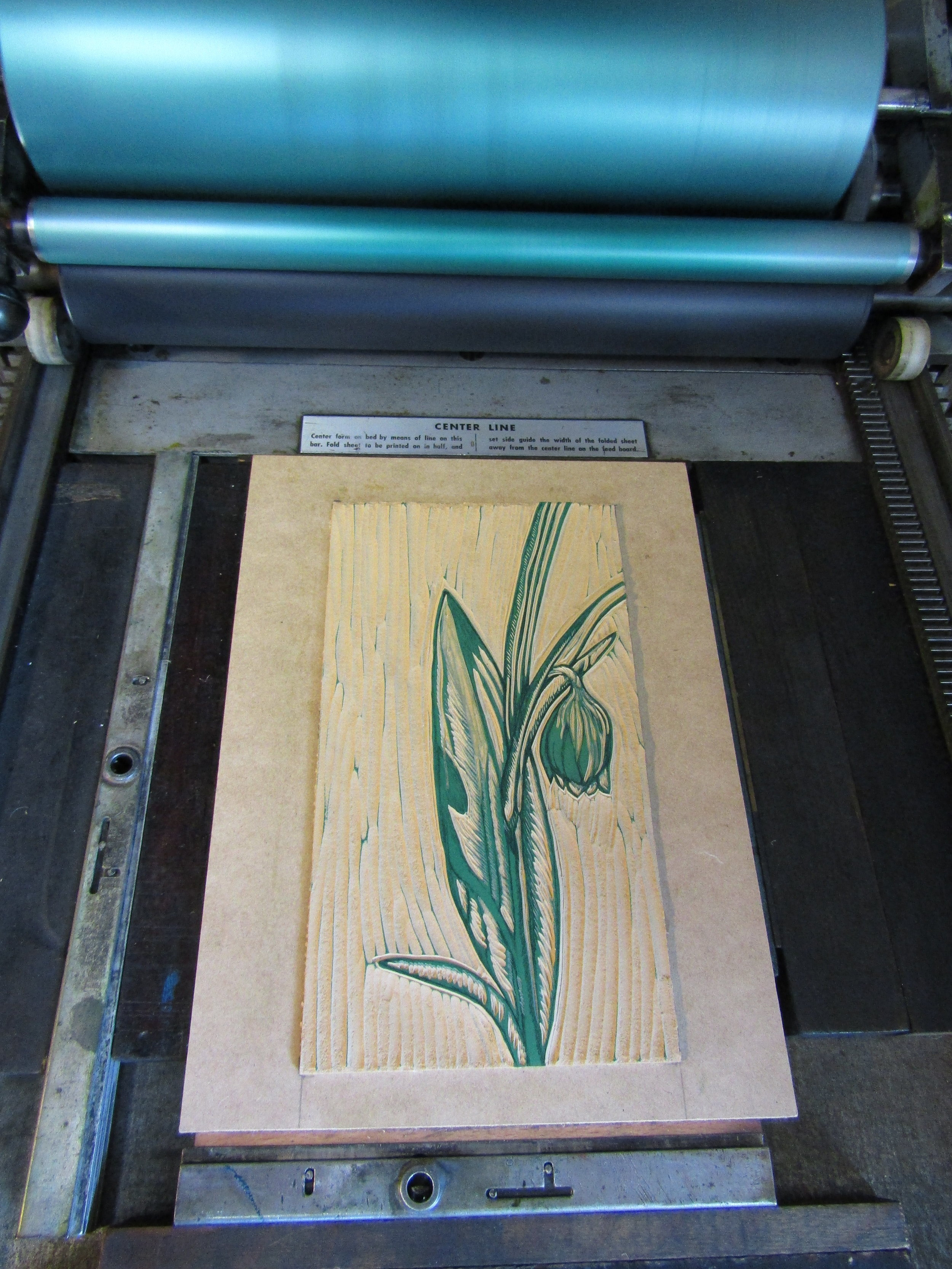 I am printing the third color - a lovely teal. The background is now carved away and I will work solely with the flower and leaves for the remainder of this print.