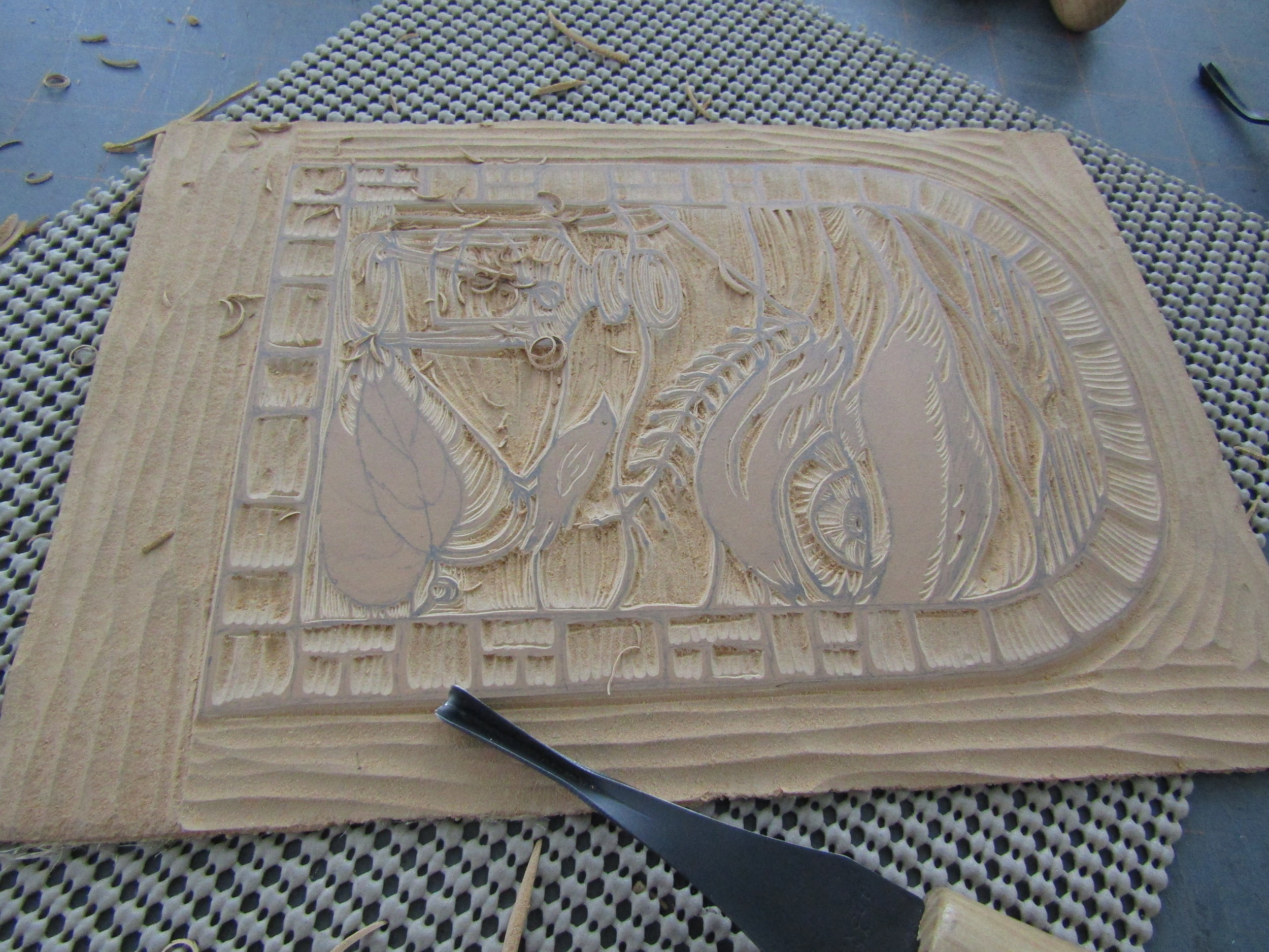 I then carved this plate based on the pencil drawing. This provided the image which was printed on the colored sections.