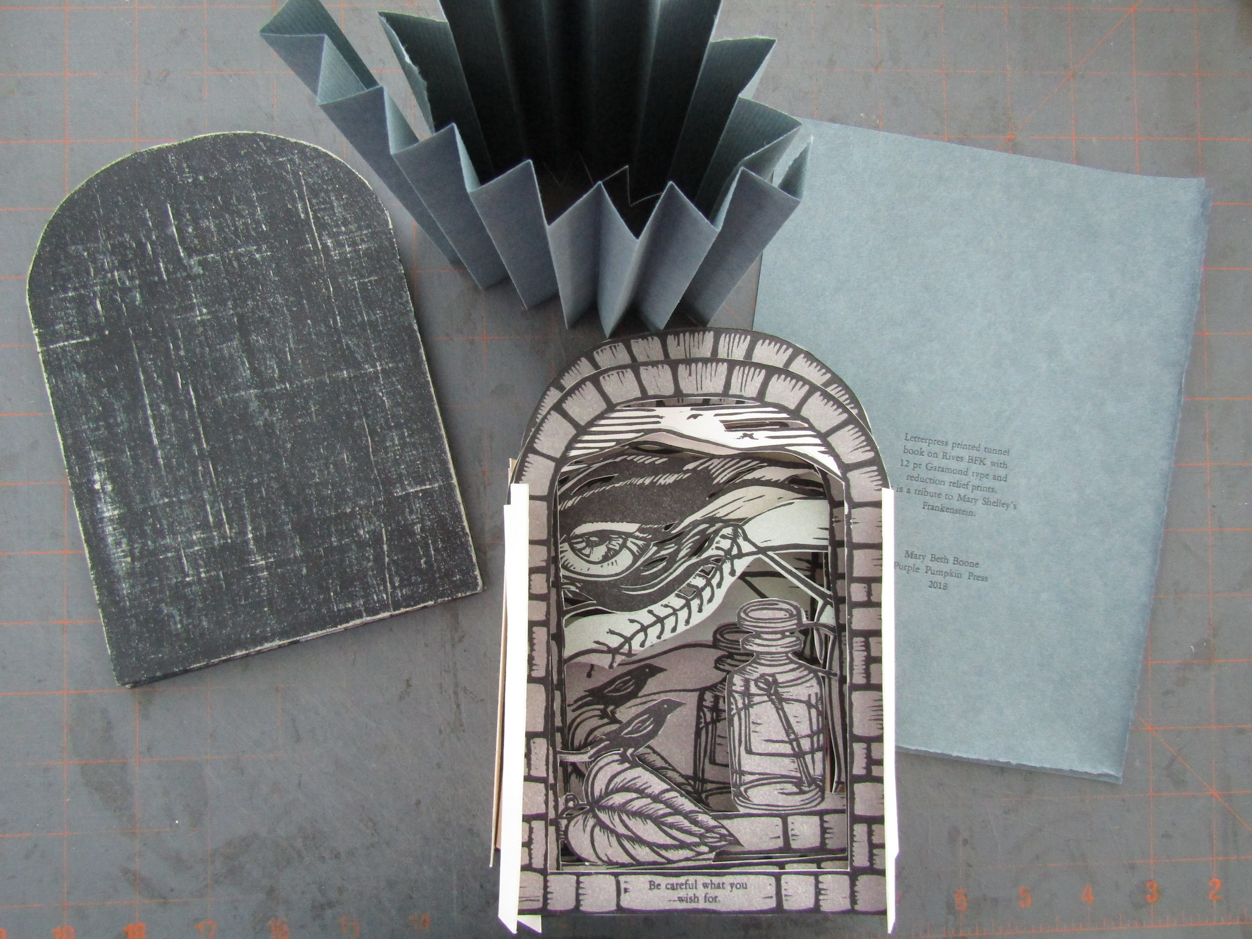All of the components - cover boards, accordion folded sides, book pages, and letterpress printed colophon. I used 12 point Garamond for the colophon and additional text. Notice the sentence that is printed across the base of the front page. It sums up my response to  Frankenstein - Be Careful What You Wish For .