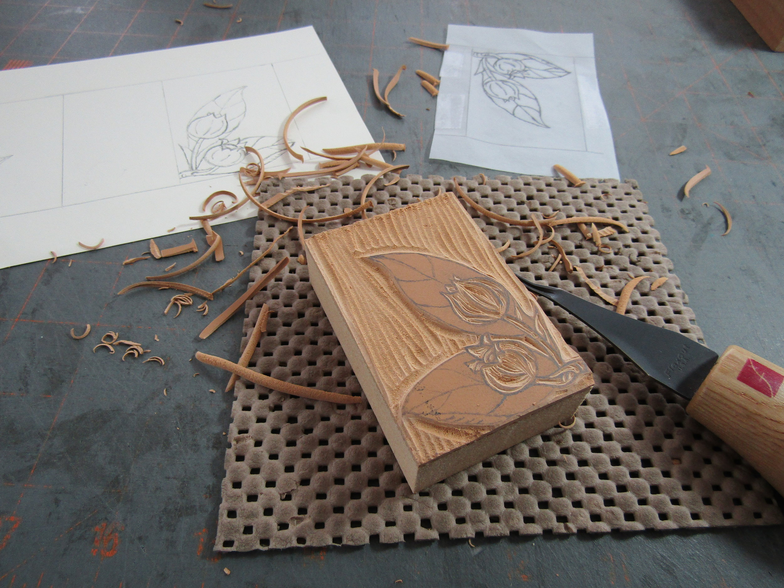 Carving the relief block. Notice the sketch, which I traced. I then transferred the image onto the block from the tracing paper image. Yes, my process is very 'old school'!