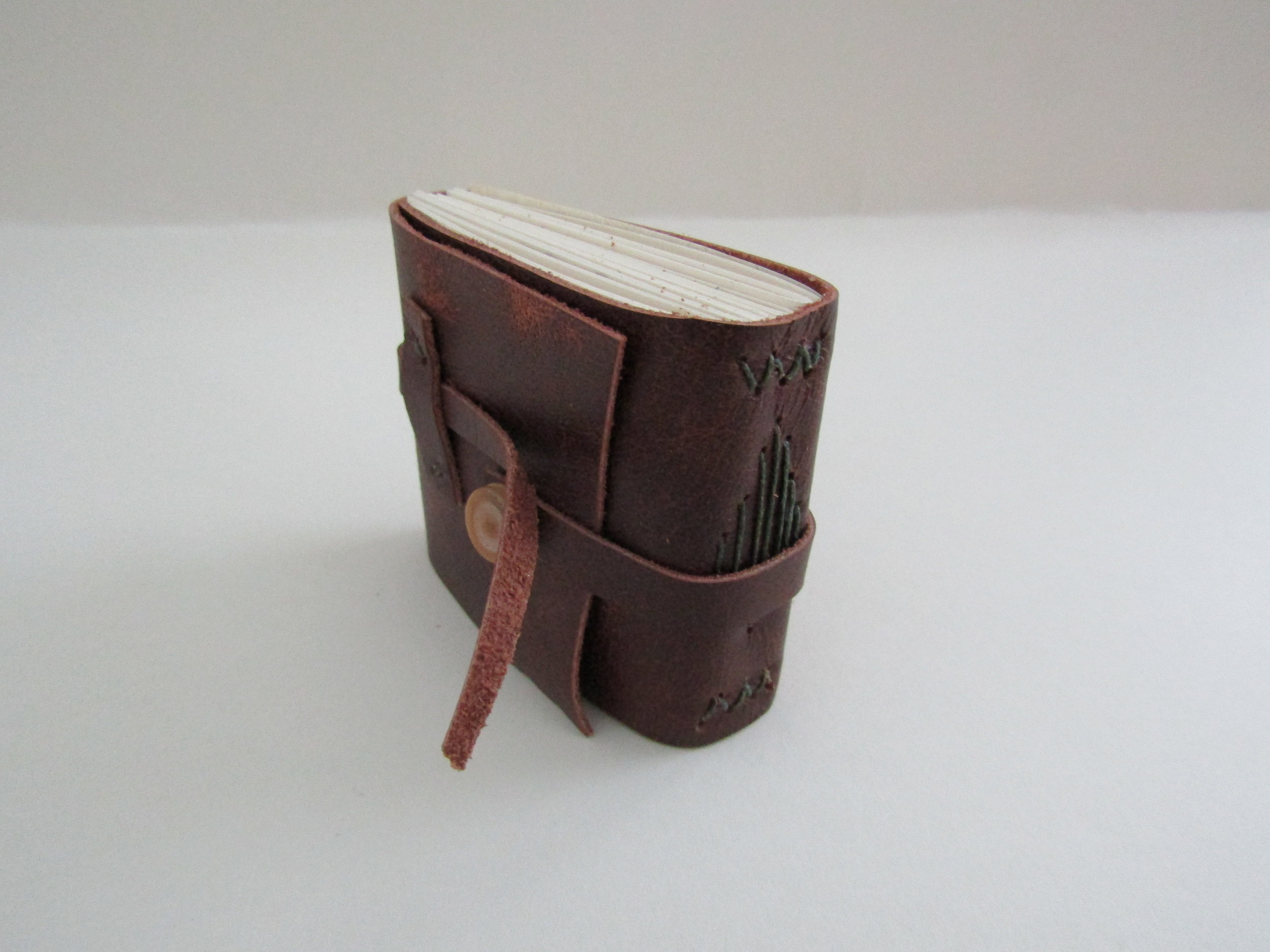 Completed brown leather journal.