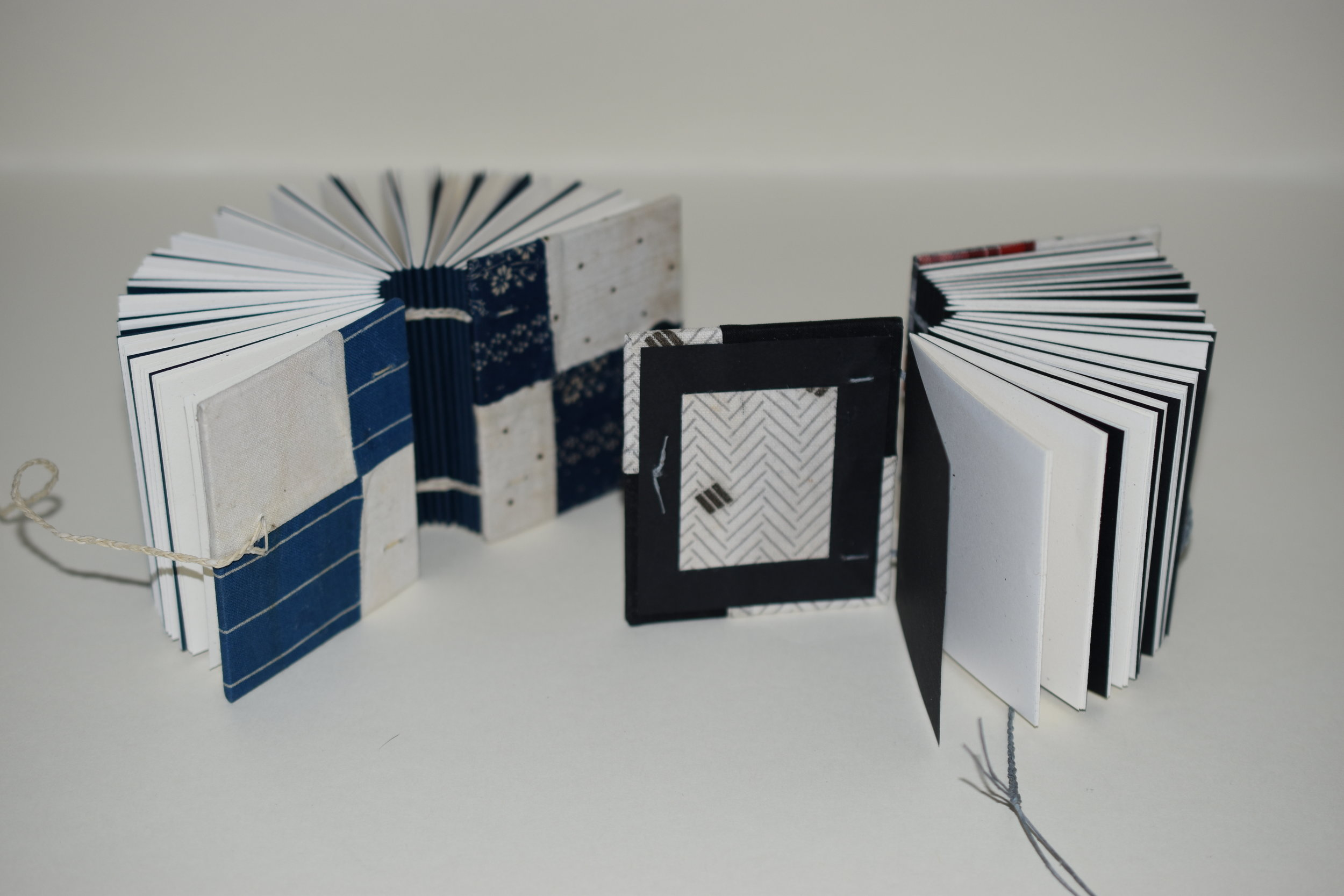 I added a bit of the fabric to the inner front covers, an element of surprise when opening and handling the books.