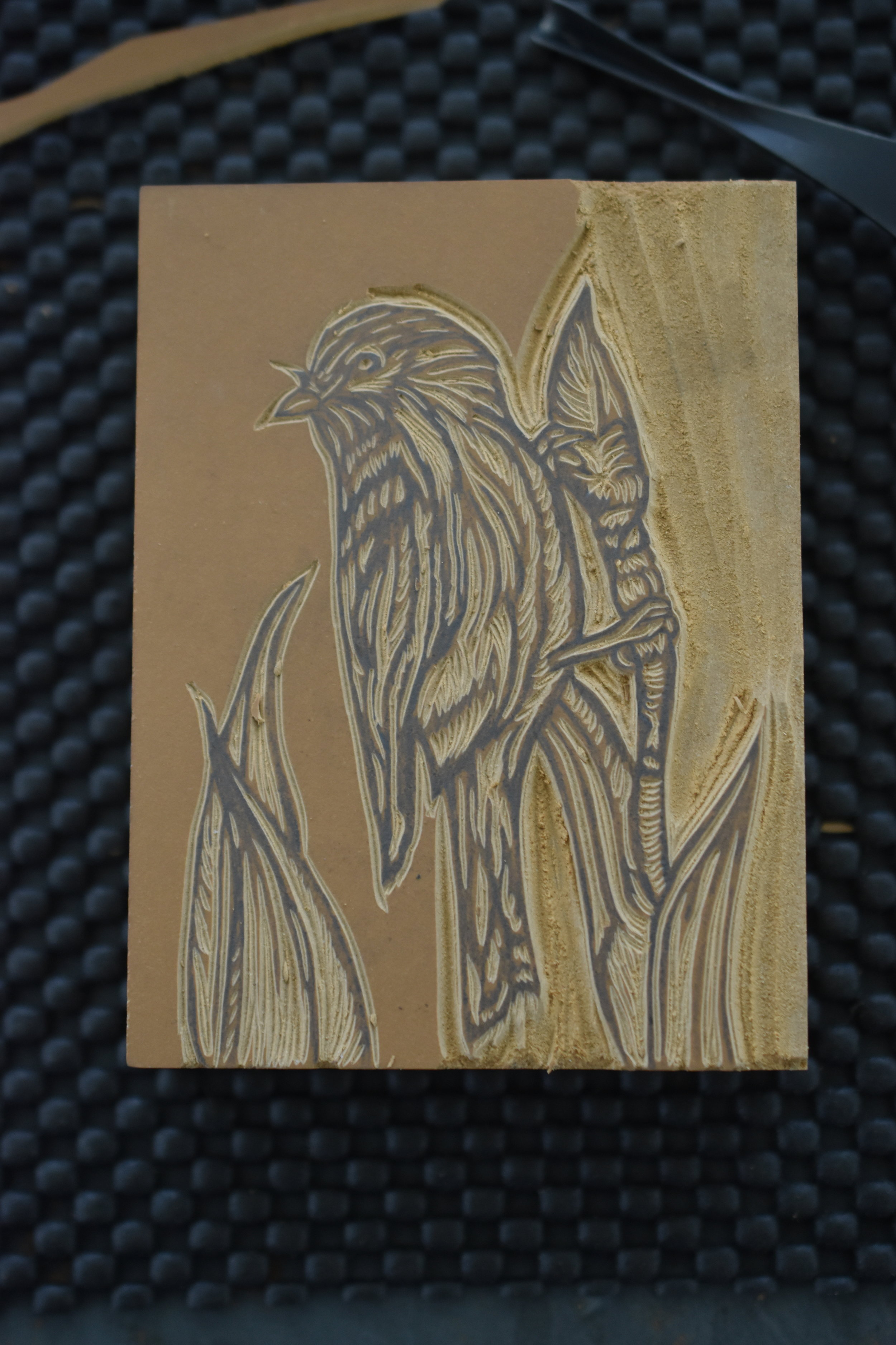 Carving the finch and the iris bud.
