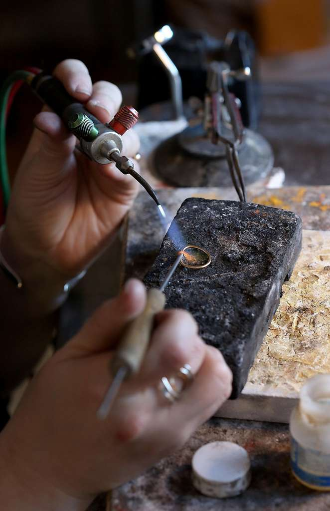 Soldering a  wedding ring  in 14 karat gold. Image by Liz Hafalia