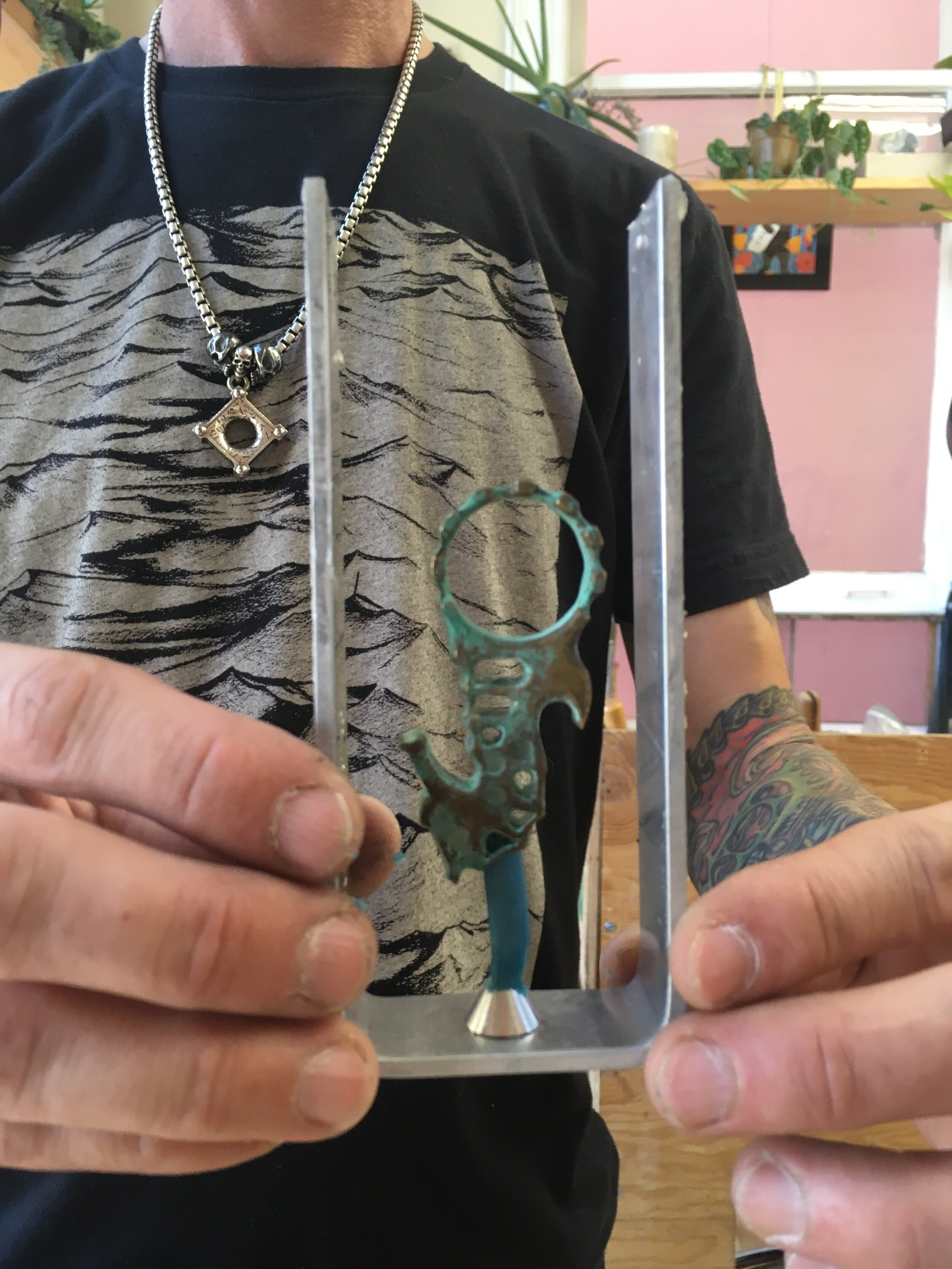 A student stands with his hand-carved seahorse—ready to pour the mold compound!