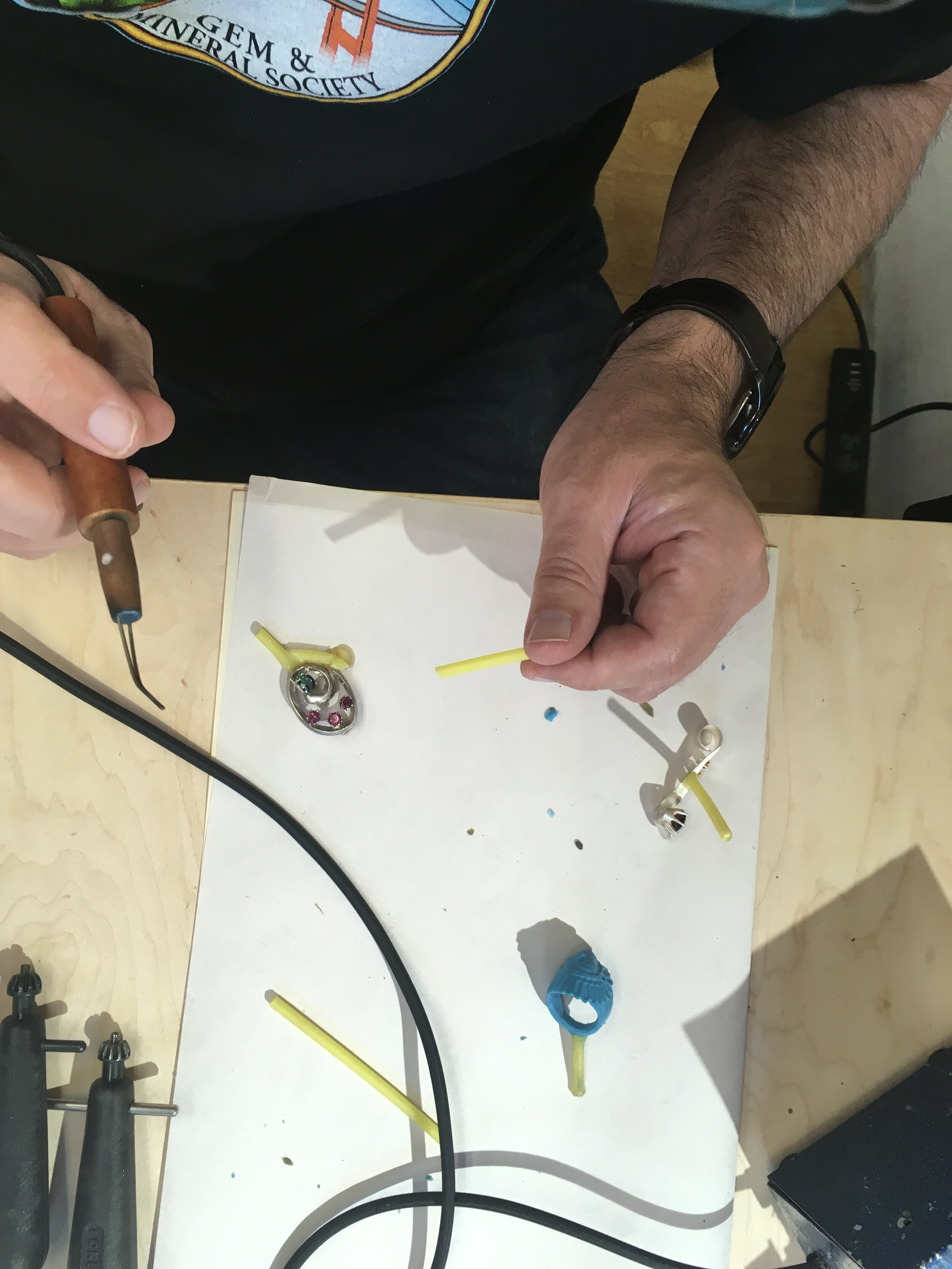 David sprues his silver jewelry pieces to make molds of them