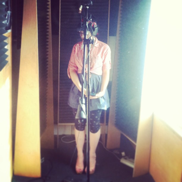 "Annette tracking vocals for ""Cute.""  Recording  A Harm Deep But Shining  at  The Jungle AE."