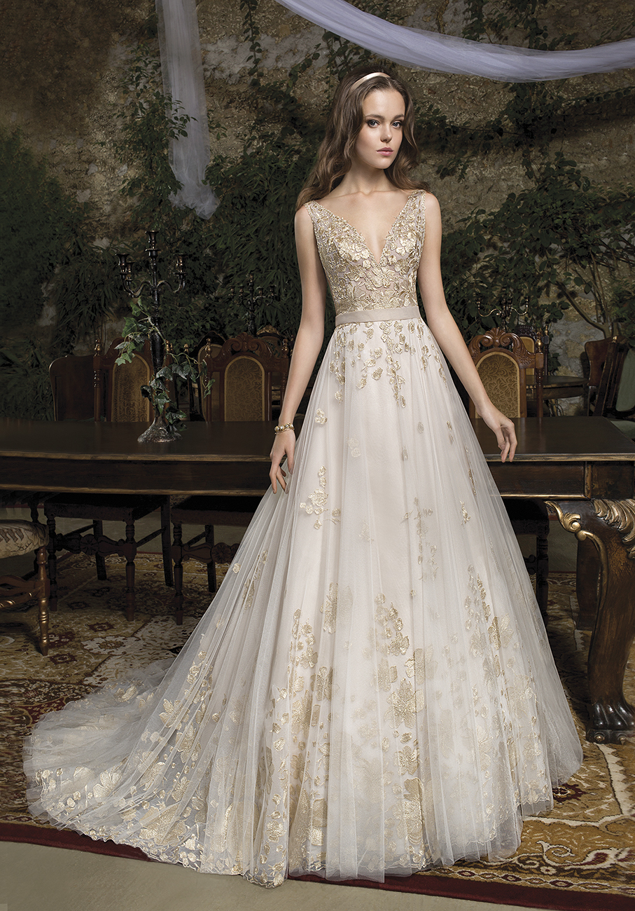 The ethereal, fairytale look of this Cosmobella 2019 dress (coming soon) captures the essence of what I would expect Meghan to wear for the wedding ceremony.