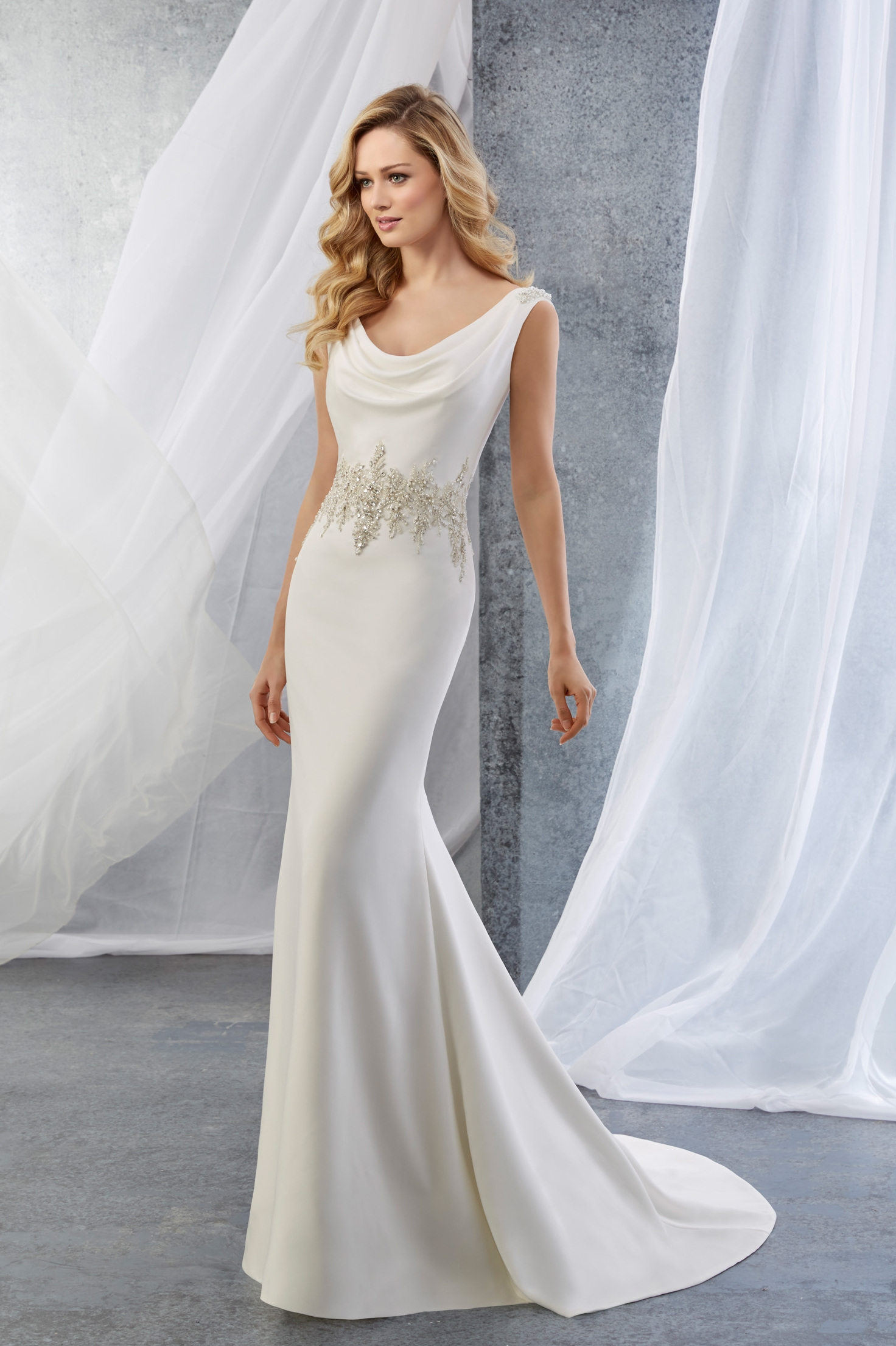 Our own 'Jenna' dress by Ronald Joyce is a beautiful take on the simple sheath dress.