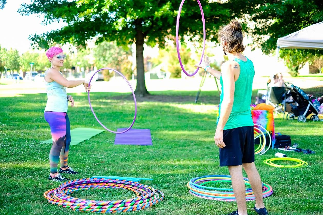 Kelsey teaches hula hoop tricks at Big Om Yoga Festival