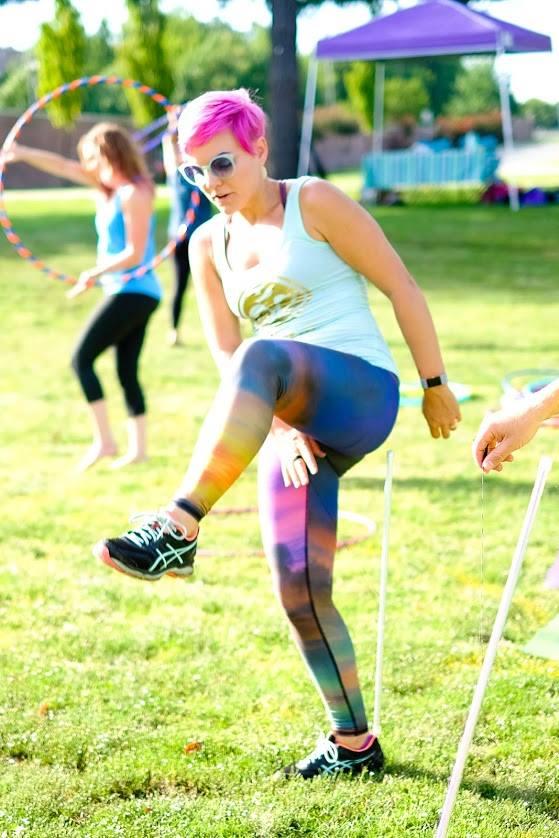 Kelsey teaches levitation wand tricks at Big Om Yoga Festival