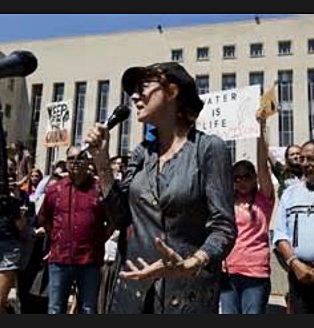 Susan Sarandon takes the mic at a protest.