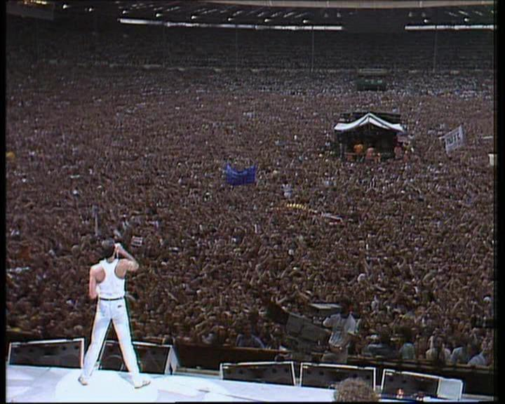 Freddy at a particularly busy General meeting (Queen at Wembley, '86)