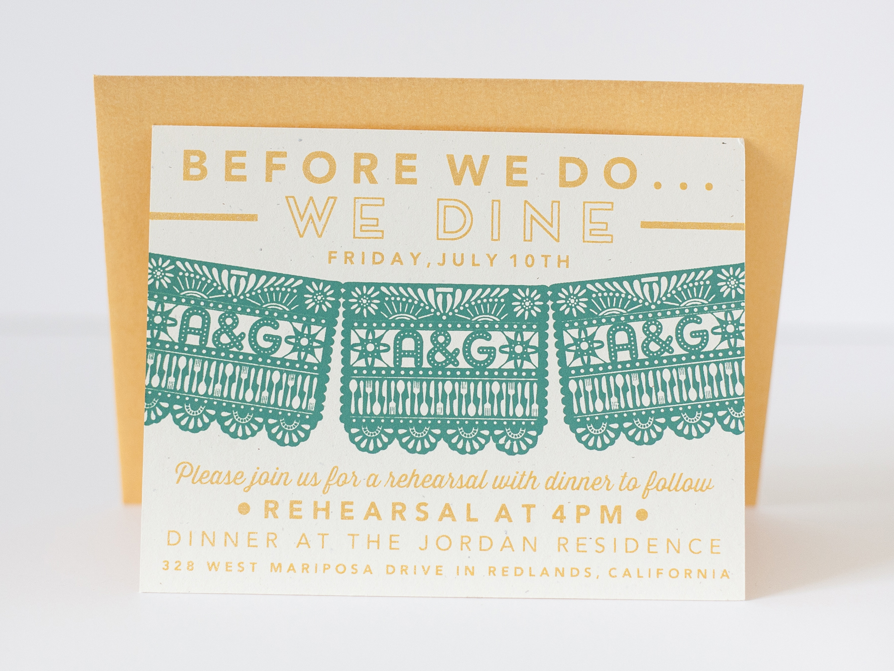 the couple had a catered Mexican rehearsal dinner and used papel picado as decor for the day of.