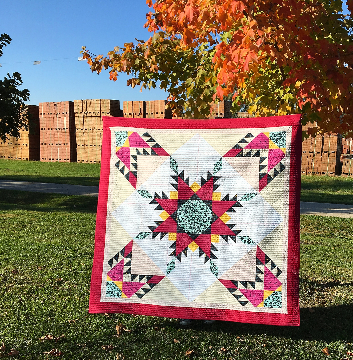 "I've provided a tutorial on how to turn TWO 36"" Fierce Feathered Star blocks into this fun lap quilt. Click here for more details!"