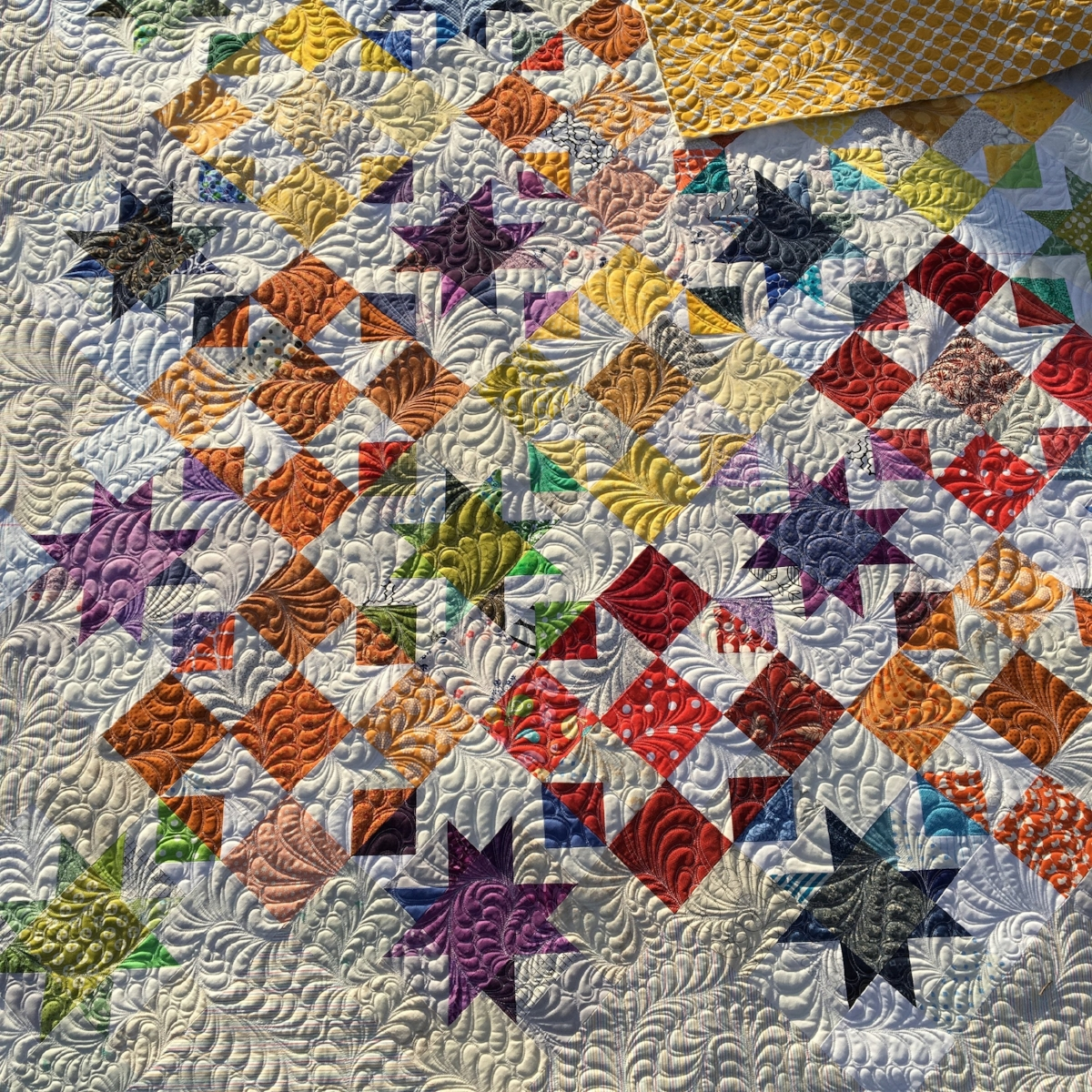Quilted with allover feathers.