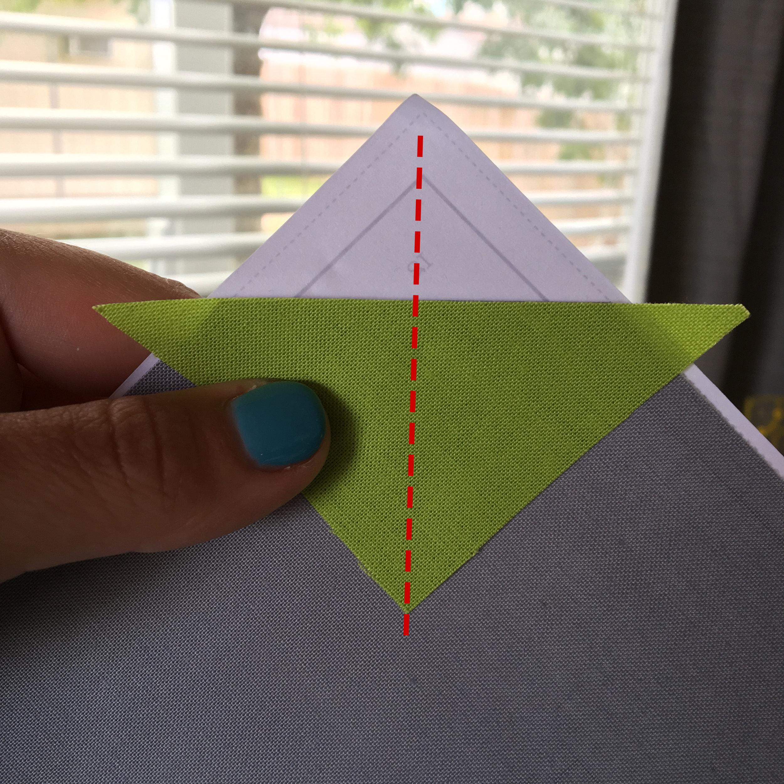 When aligning a triangle piece along its bias side as illustrated here, imagine a straight line traveling from the corner of the area you will be covering, with the right angle of the triangle you're adding, like shown above. Use this technique with all applicable units.