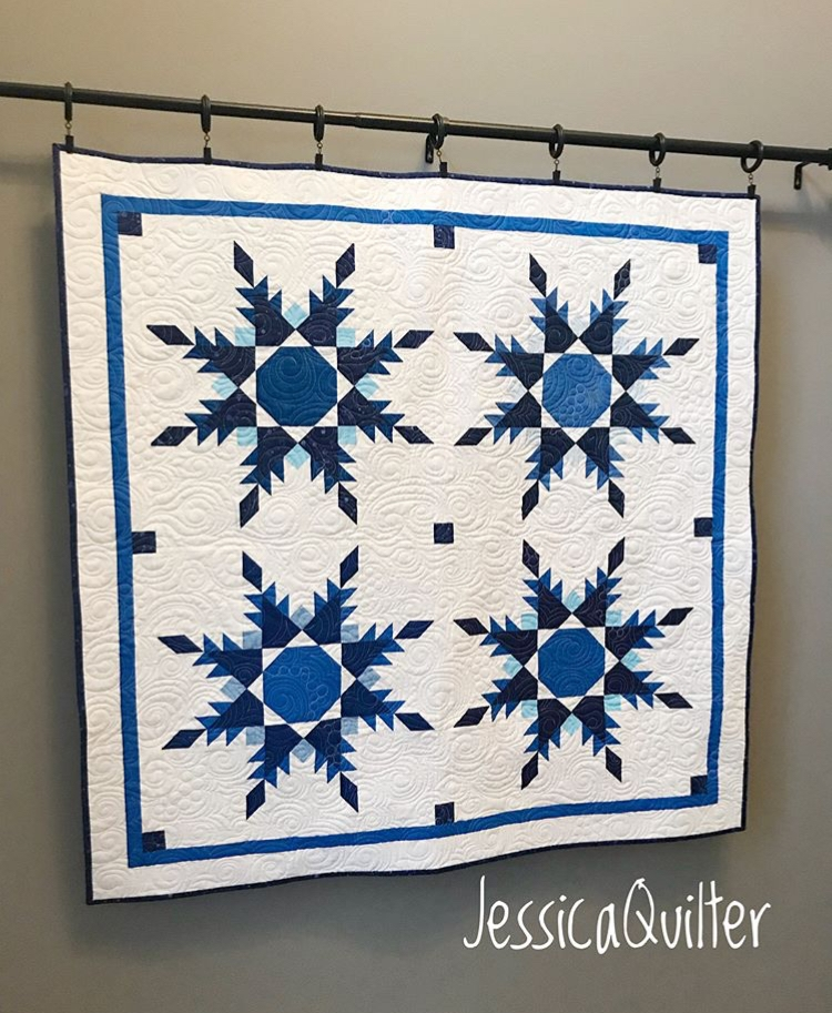 "JessicaQuilter  made her own layout design using the 20"" feathered stars. Look at her beautiful quilting!"