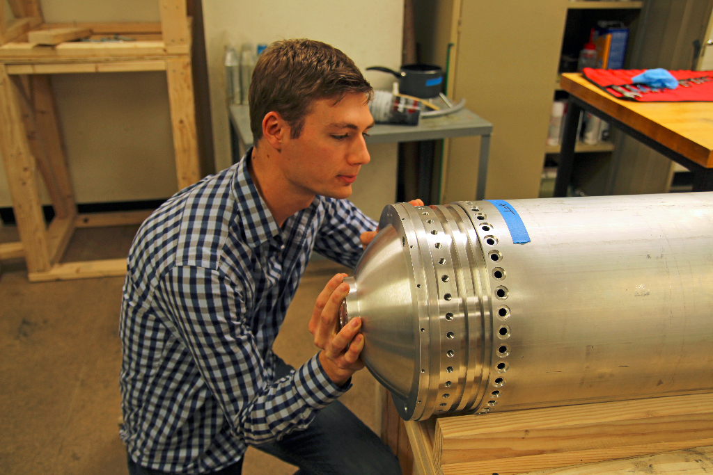 Armor Harris test fitting an oxidizer tank bulkhead onto the Starscraper rocket