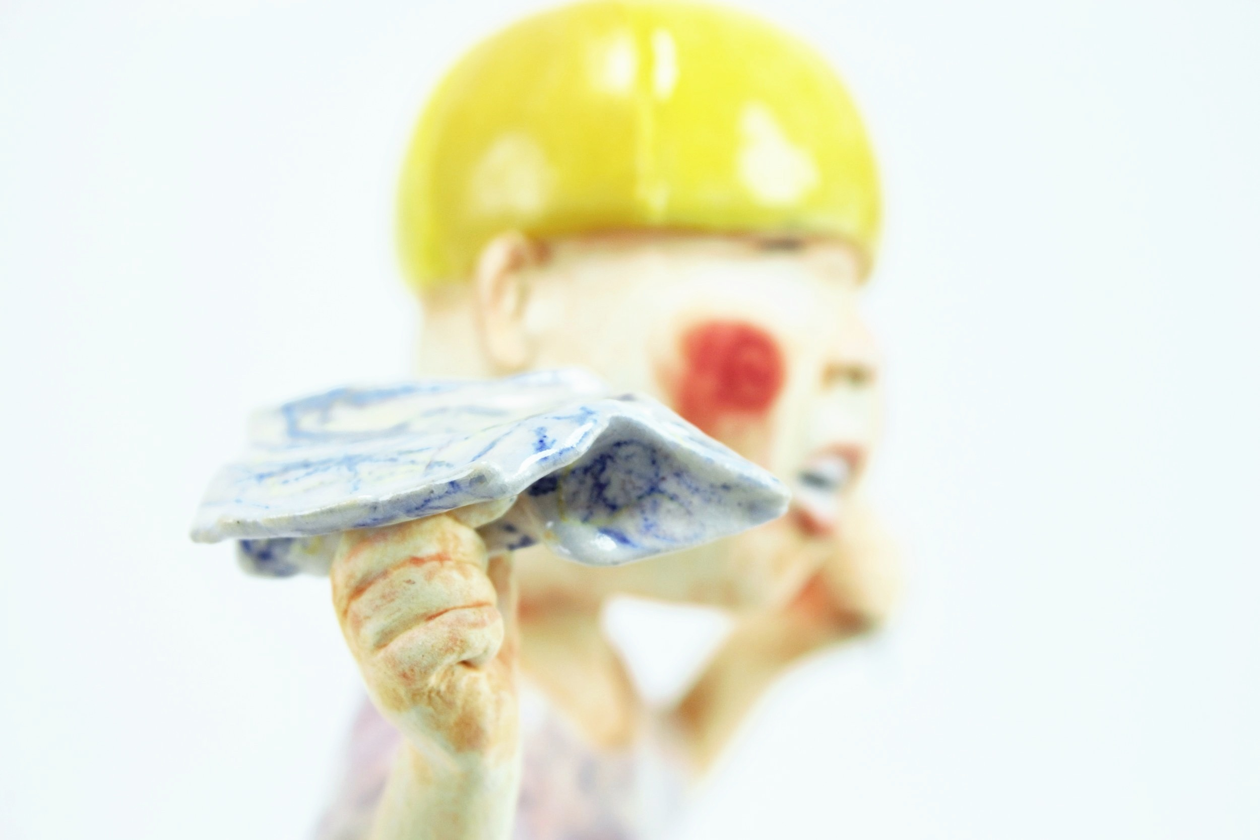 Boy in Yellow Cap Detail