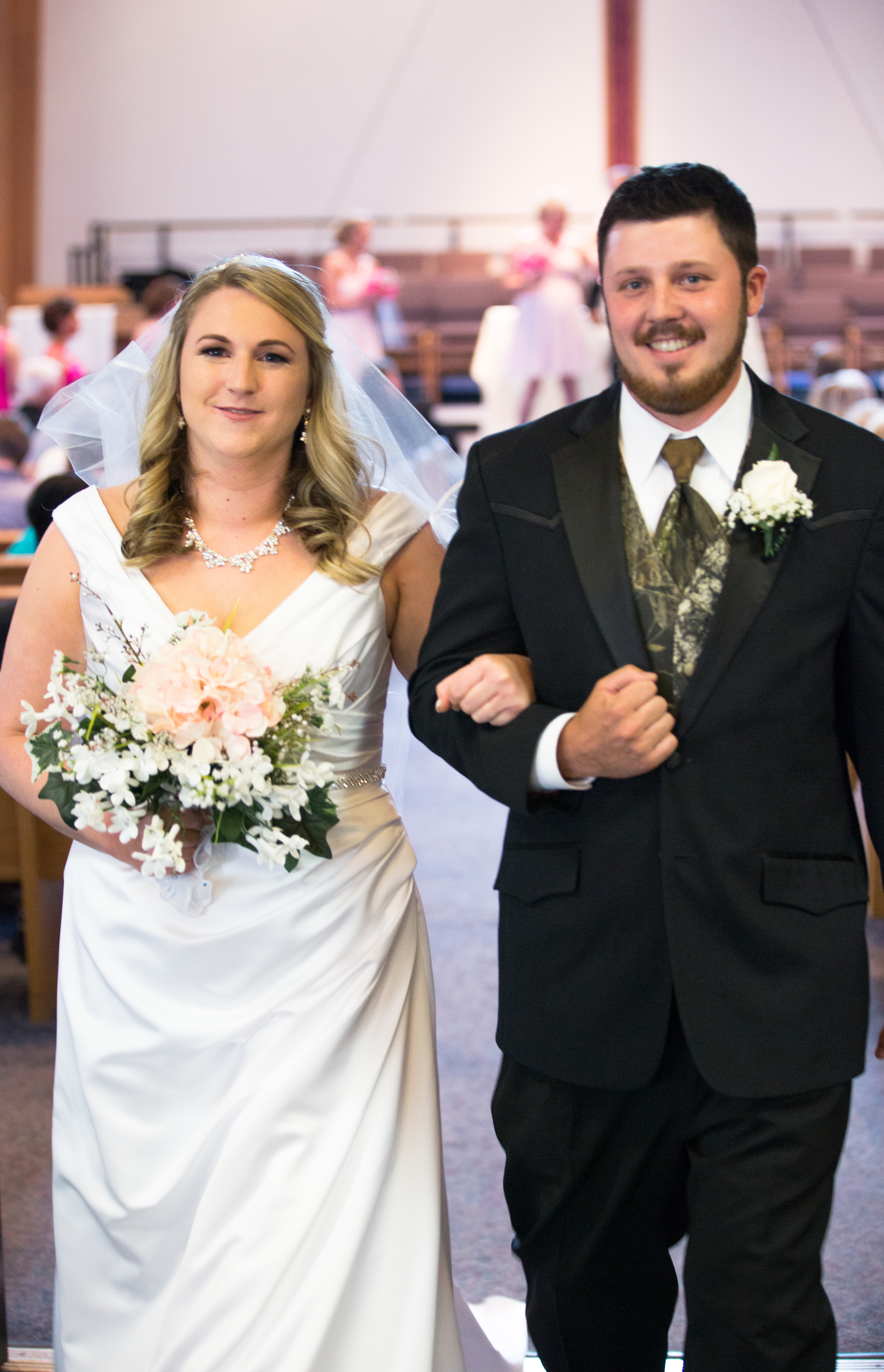 bride_and_groom_leaving_ceremony_synan