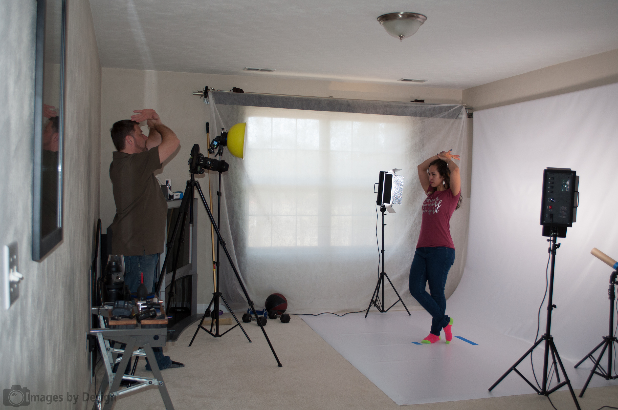I recently created this home studio so I can constantly practice.  Here I'm directing a model during a catalog shoot for a local T-Shirt company.