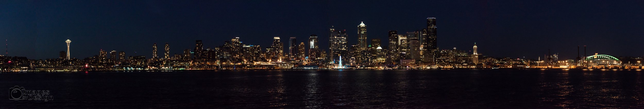 Night time Seattle cityscape as seen from Puget Sound.  ©2017 Images by Design