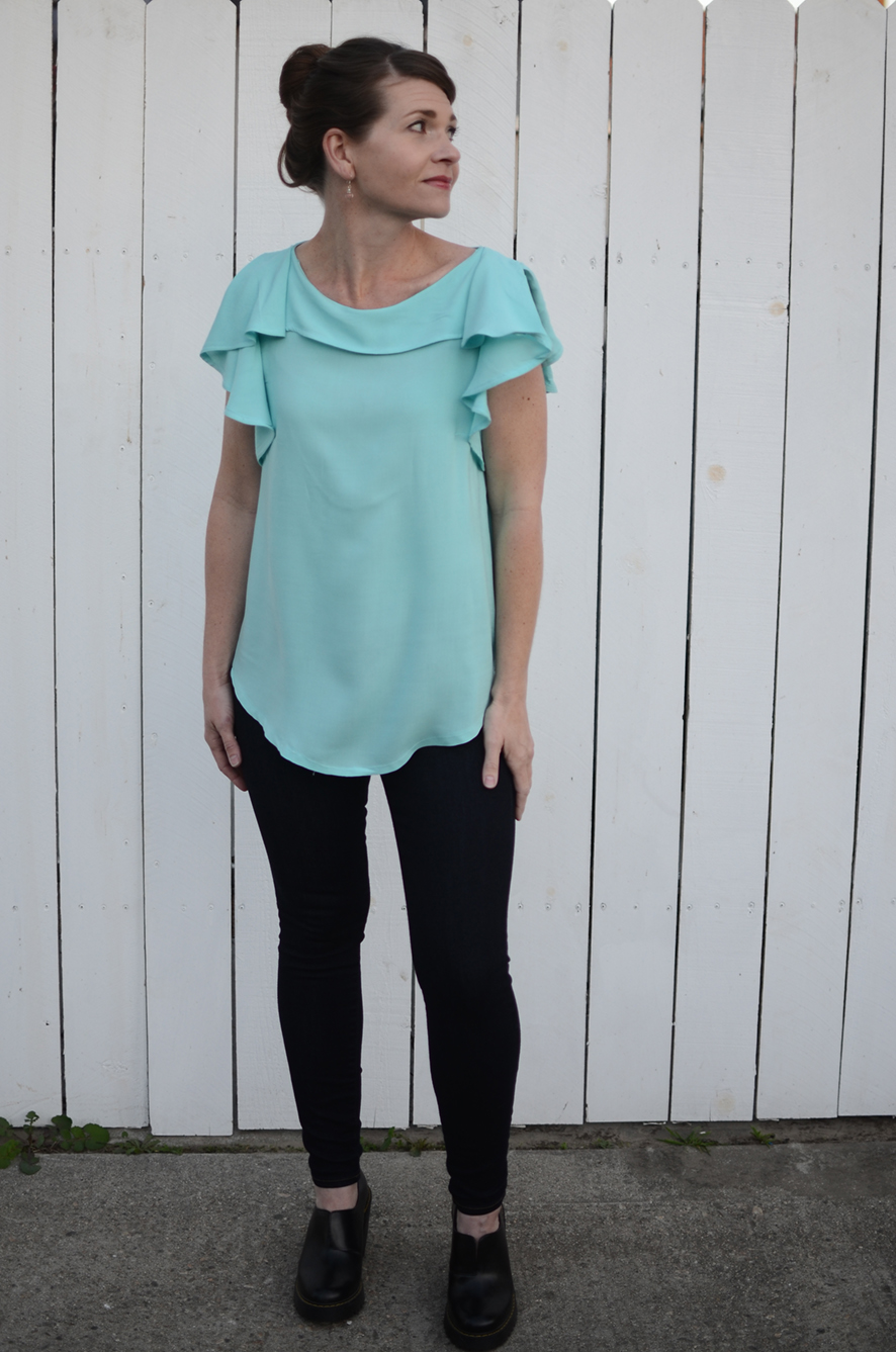 """Katie Kennedy - """"I'm thrilled with my two versions of the Synthia Blouse. The shell is so simple and easy to wear, and works for so many different fabrics. I can see myself making this in a basic chambray as well as a host of solids to boost my wardrobe. The ruffle addition is just a cherry on top; a really special and feminine detail when the need for a more dressed up option arises."""""""