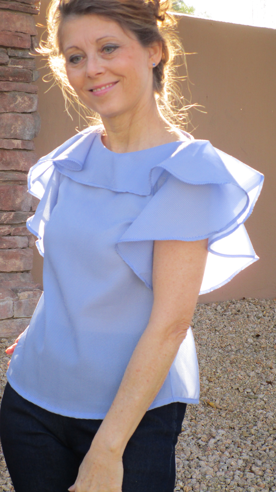 """Diane Cullum - """"When I saw the drawings of the Synthia, I loved the simplicity of the blouse with the circle type of ruffle. I really like how it drapes down the arms, creating a very different look. It's romantic and flirty, floaty and fun. Since I love sewing with woven fabric, and this blouse can be dressed up or worn casual."""""""
