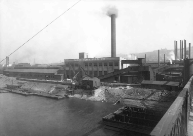 Exterior of Oliver Iron and Steel Works as seen from 10th Street Bridge. (1913)