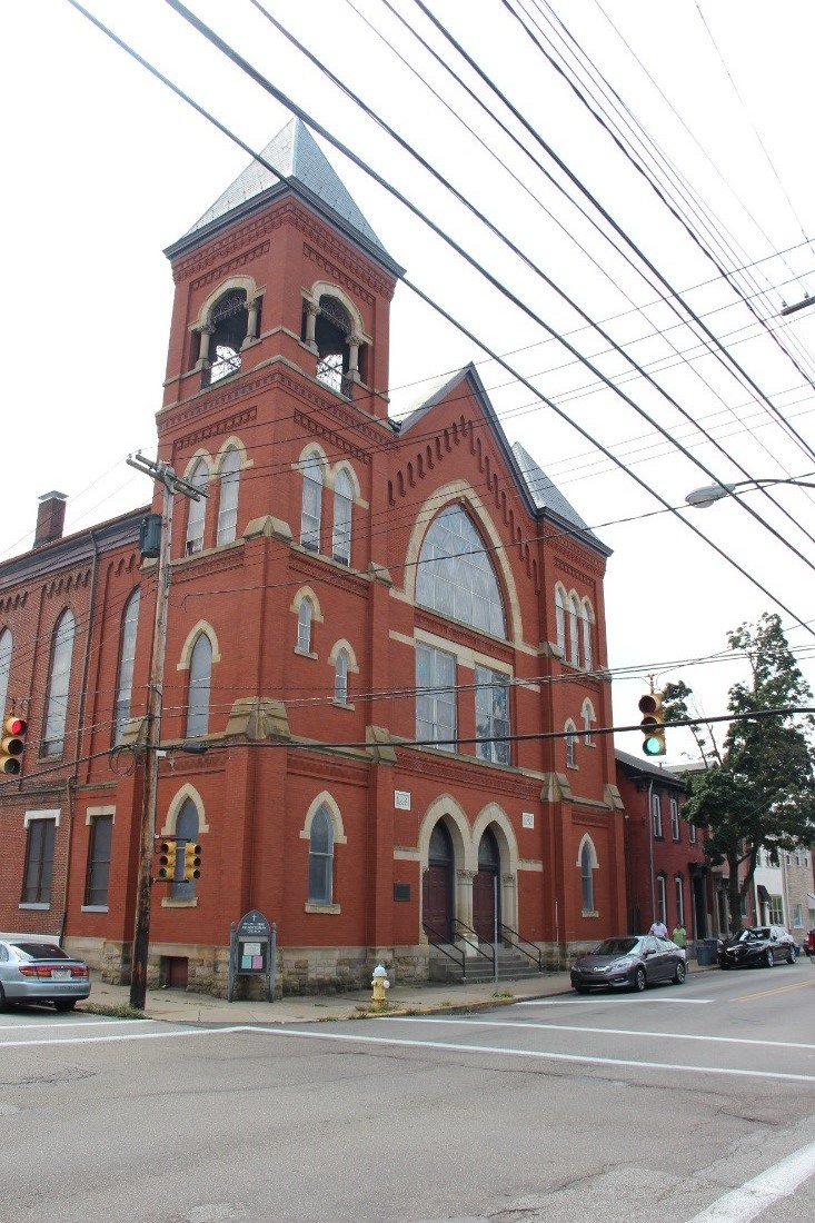 6 View southwest along Sarah Street showing overview of north (front) façade (the first bay with towers and narthex is an 1893 addition.jpg