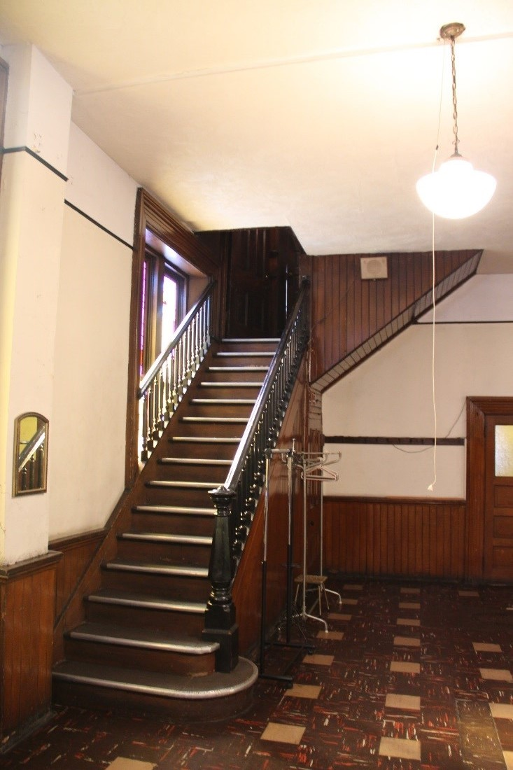 28 View south showing stairs (original to 1869) leading from Sunday school room to the rear of the sanctuary on the second floor.jpg
