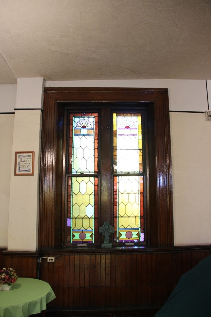 31 Detail of a typical stained glass window and wainscot in the 1st floor Sunday school room.jpg