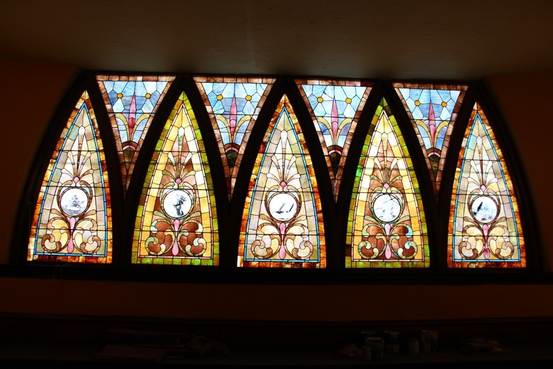 58  View north, showing detail of balcony stained glass window; the arched sashes are operable via a center horizontal pivot.jpg