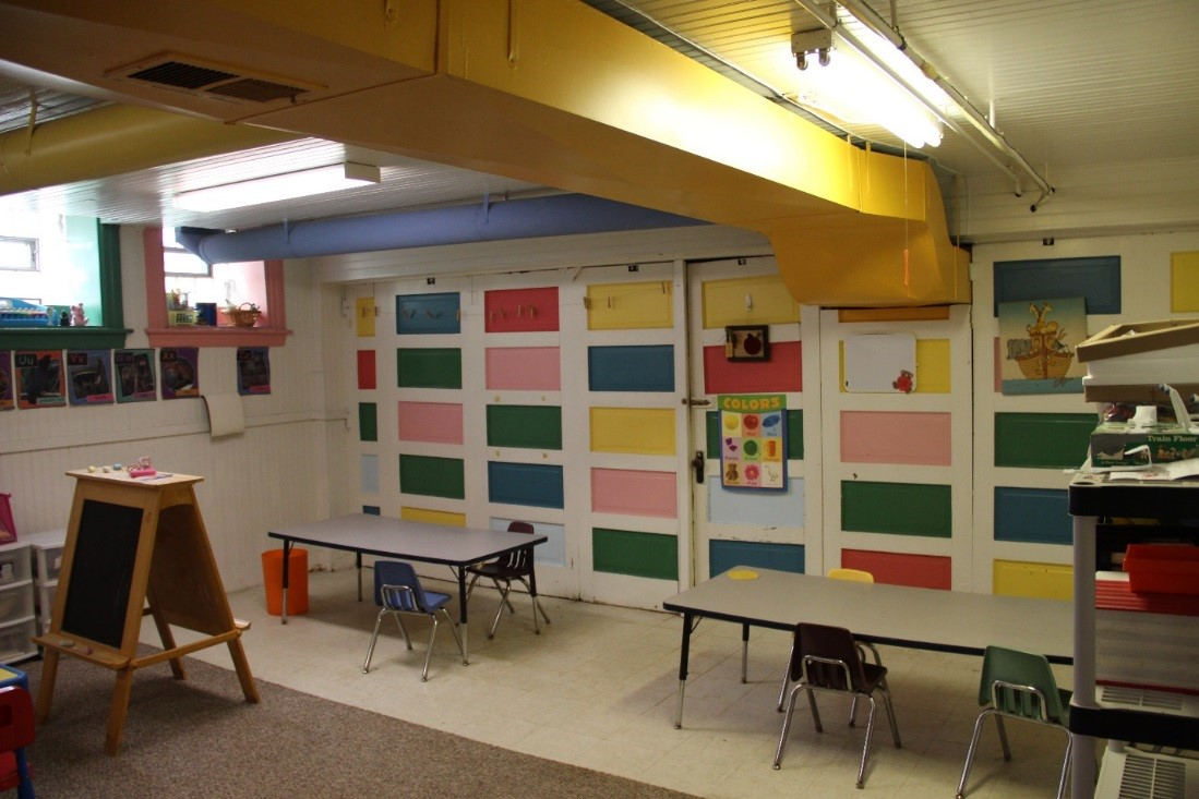 74 View southwest showing pre-school room in gym basement.  The gym basement formerly contained shower and locker rooms.jpg