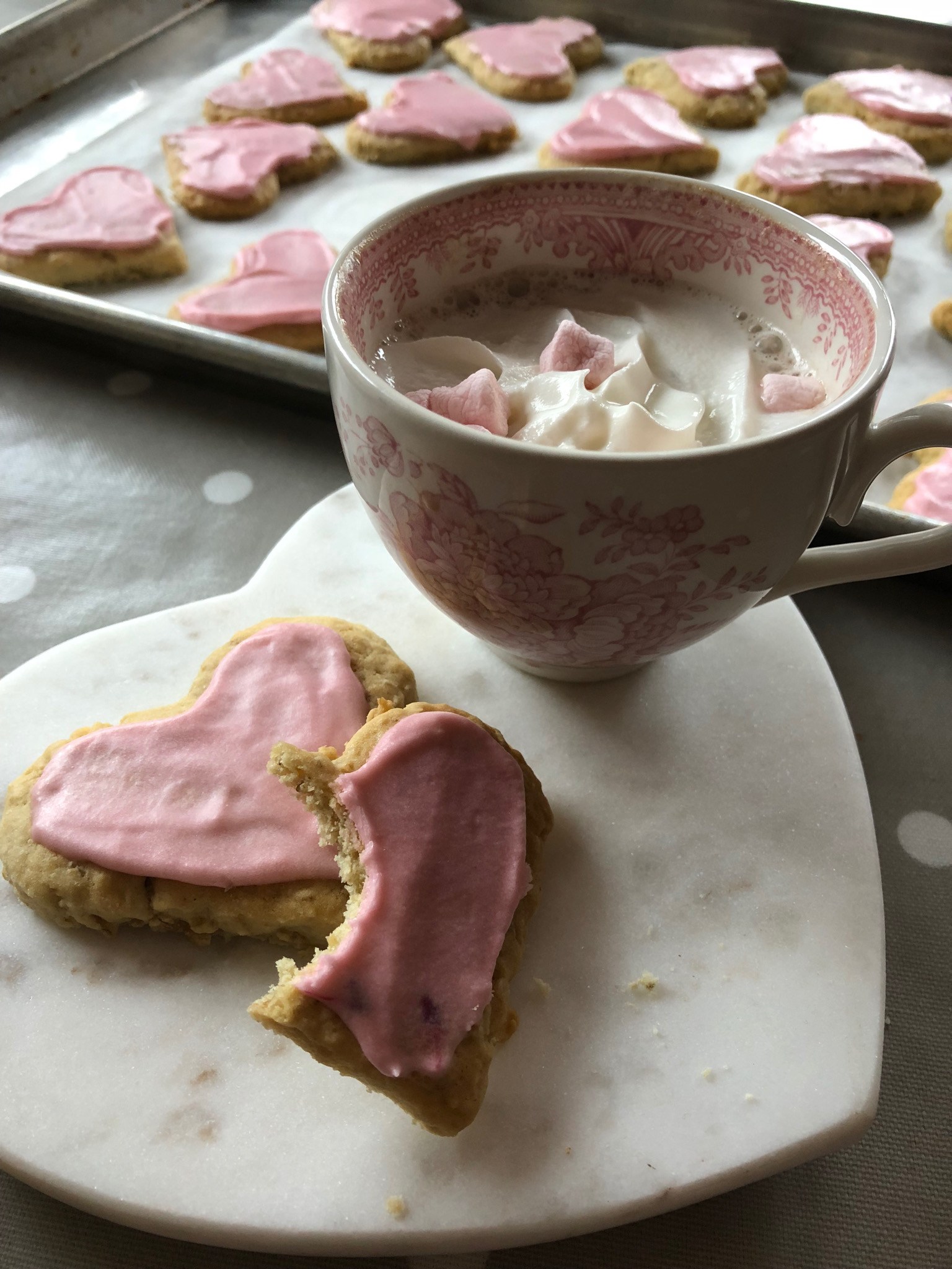 Lisa's Valentine's Day Cookies - 1 1/3 cup soft butter2 cups sugar2 eggs2 tsp. vanilla1/2 cup water4 1/2 cups flour1 tsp. salt1 tsp. soda3 cups oatsBeat butter and sugar until fluffy. Add eggs and vanilla and water.Stir together the flour, salt and soda. Add into butter moisture and blend well.Stir in oats.. Chill 1 hour.Pre-heat oven to 350. Roll out dough with flour and cut into hearts. Bake on un-greased cookies sheets for 12 minutes.When cool, frost with pink and white butter cream frosting.