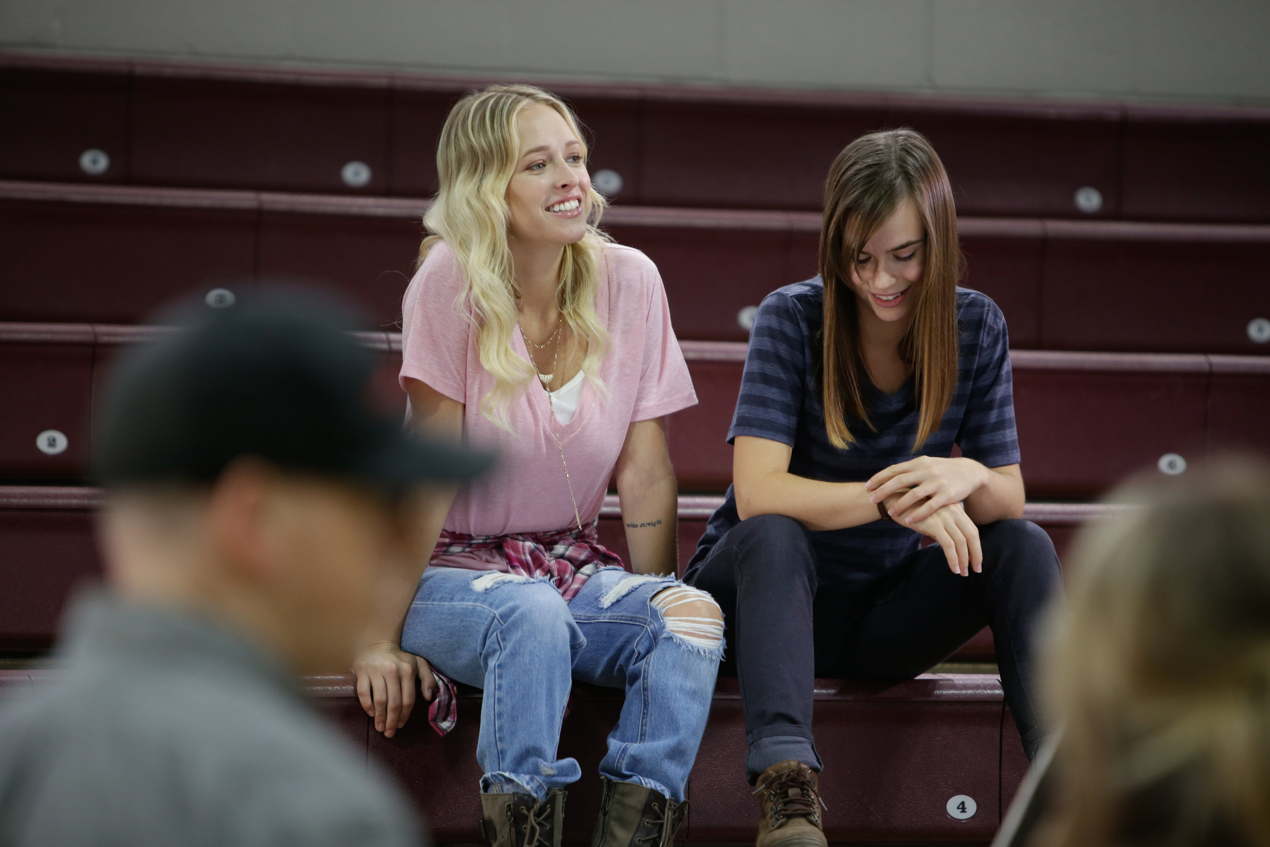 Audrey Neal (Cat Ryan) and Ema Horvath (Maxine Laret) enjoying the high life in the bleachers in the Fresno Christian gymnasium. Which did not smell, by the way. Cleanest gym I've ever been in. Photo Credit: Cody Allred