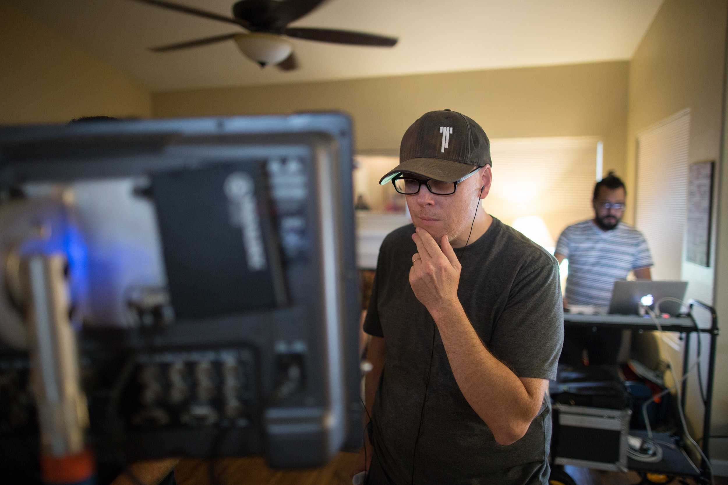 Me checking out a shot while Script Supervisor Orlando Gomez does his thing in the background. This picture was not posed. At all. I thoughtfully put my fingers to my chin, like, all the time. Photo Credit: Cody Allred