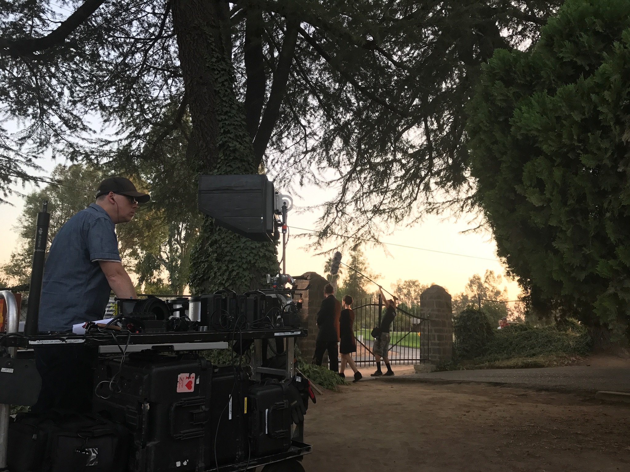 I watch monitor closely as actor Gregory C. Tharpe (Kevin) and Ema Horvath make their way out of the cemetery while Sound Engineer Tyler Smith follows them like a creeper. Photo Credit: Jenny Pauline-Mendoza