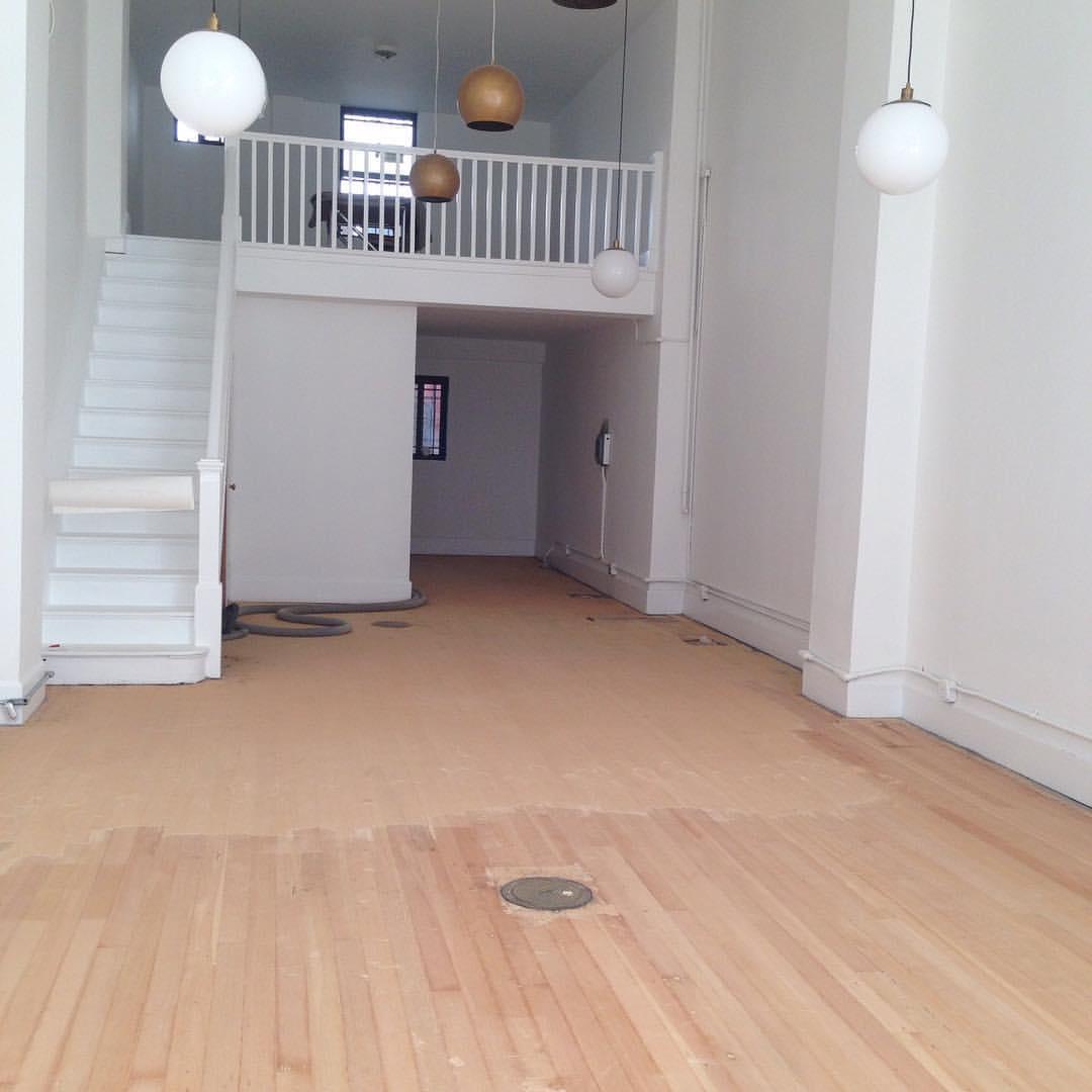 Sanding the floors!