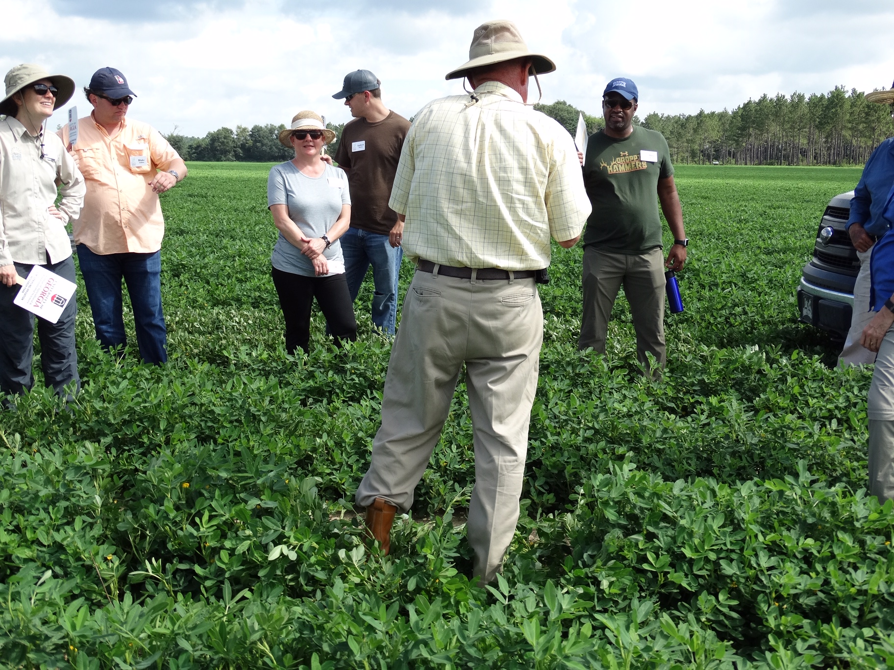 Local farmer Murray Campbell discusses peanut production on a farm tour with IGEL participants.