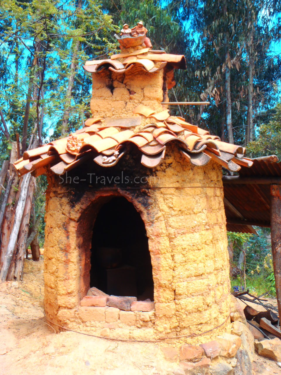 ©She-Travels.com - Clay oven to bake her art