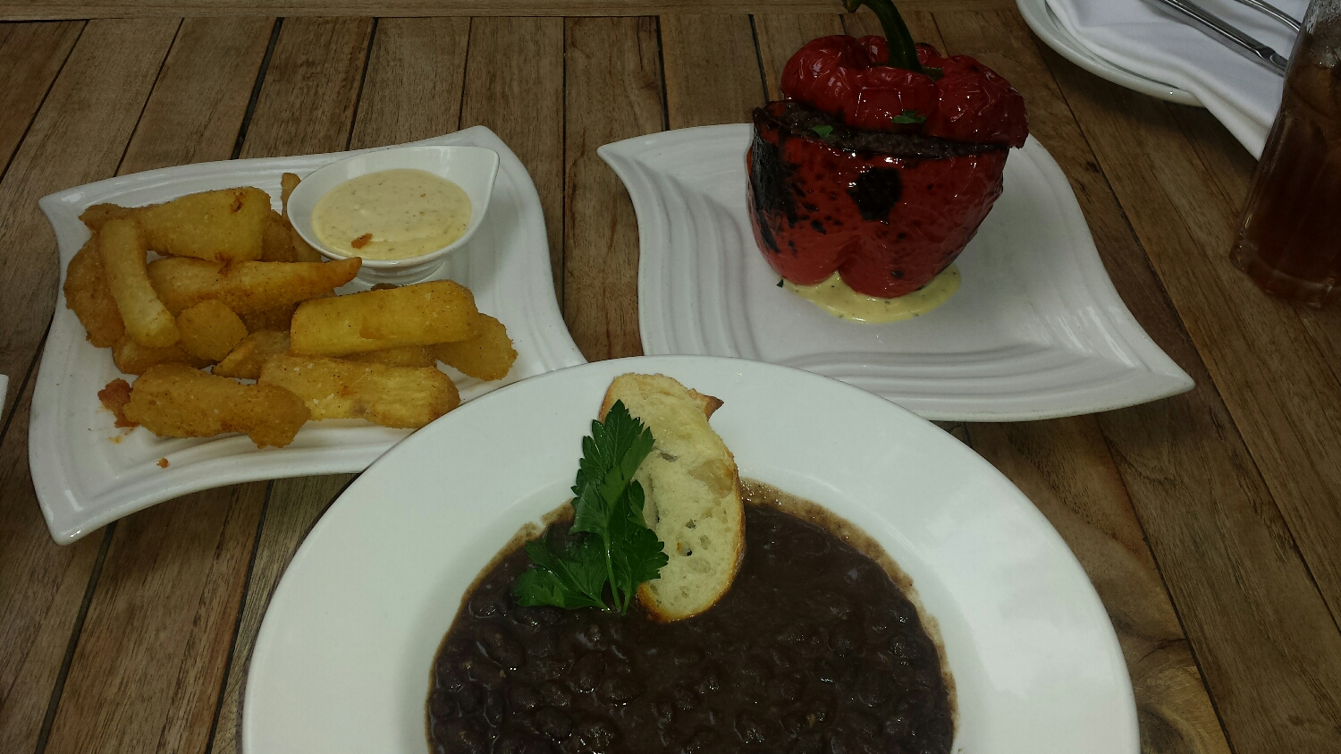 Yuca fries, black bean soup, stuffed pepper with congri