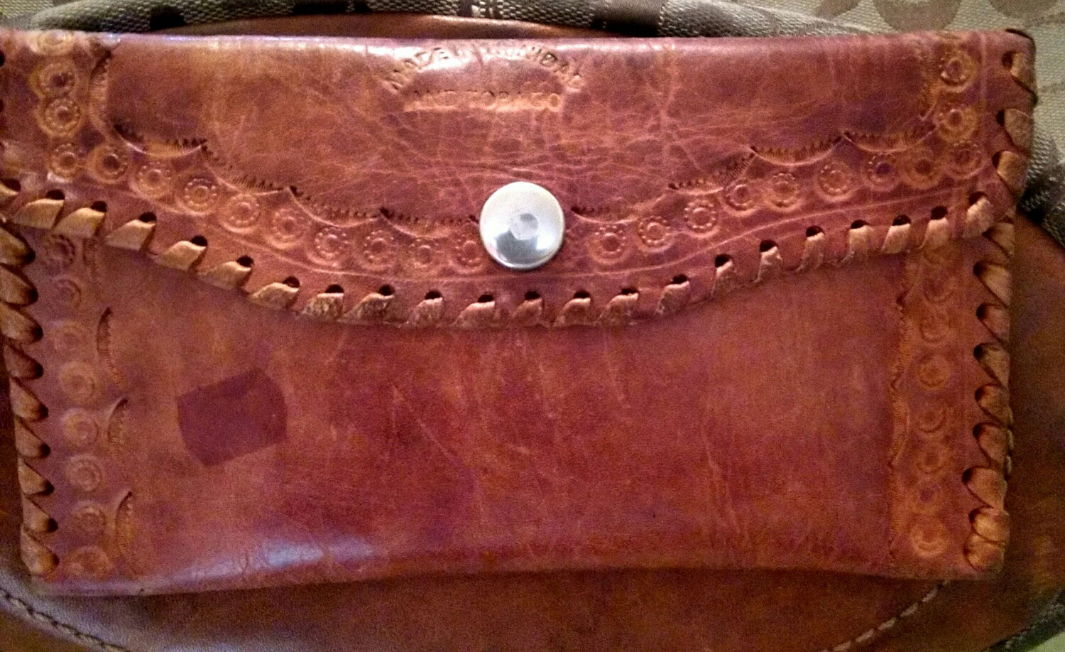 Leather wallet purchased in 2009 in Buccoo Reef Tobago