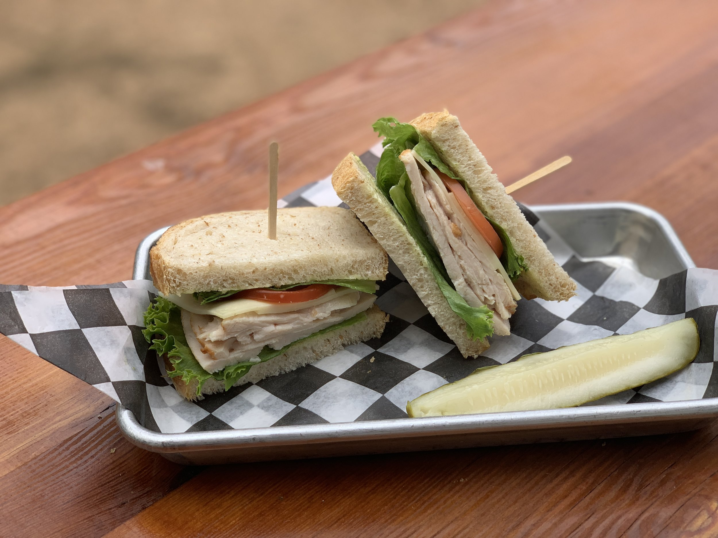 The Fitzhugh - Turkey, provolone and pesto mayo on sourdough bread. Add bacon for $1