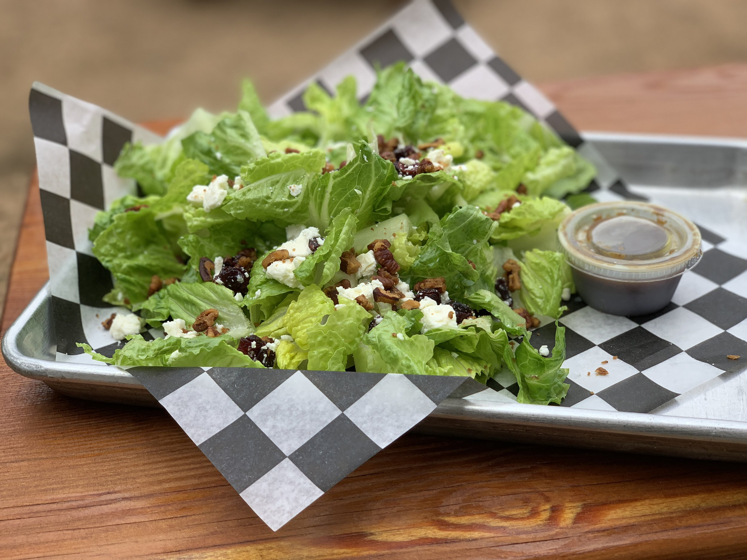 Harvest Salad - spicy, candied pecans, feta and cranberries on a bed of romaine with balsamic vinaigrette dressing